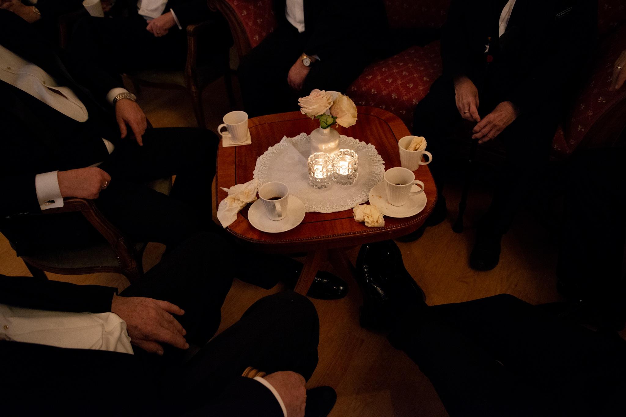 Men in Black around the table by Goran Jorganovich