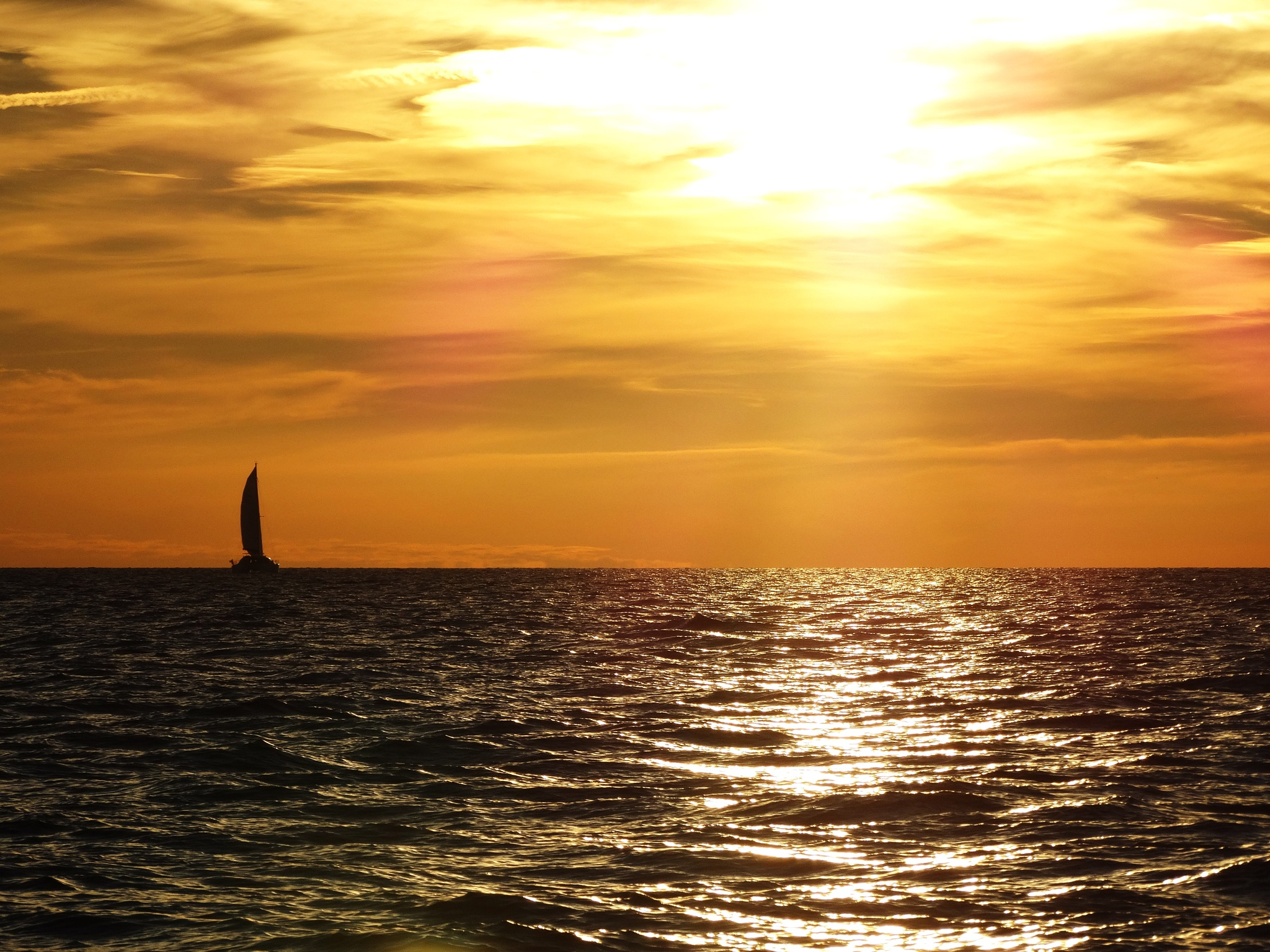 Golden Sunset and lonely sail by Ivars Duntavs