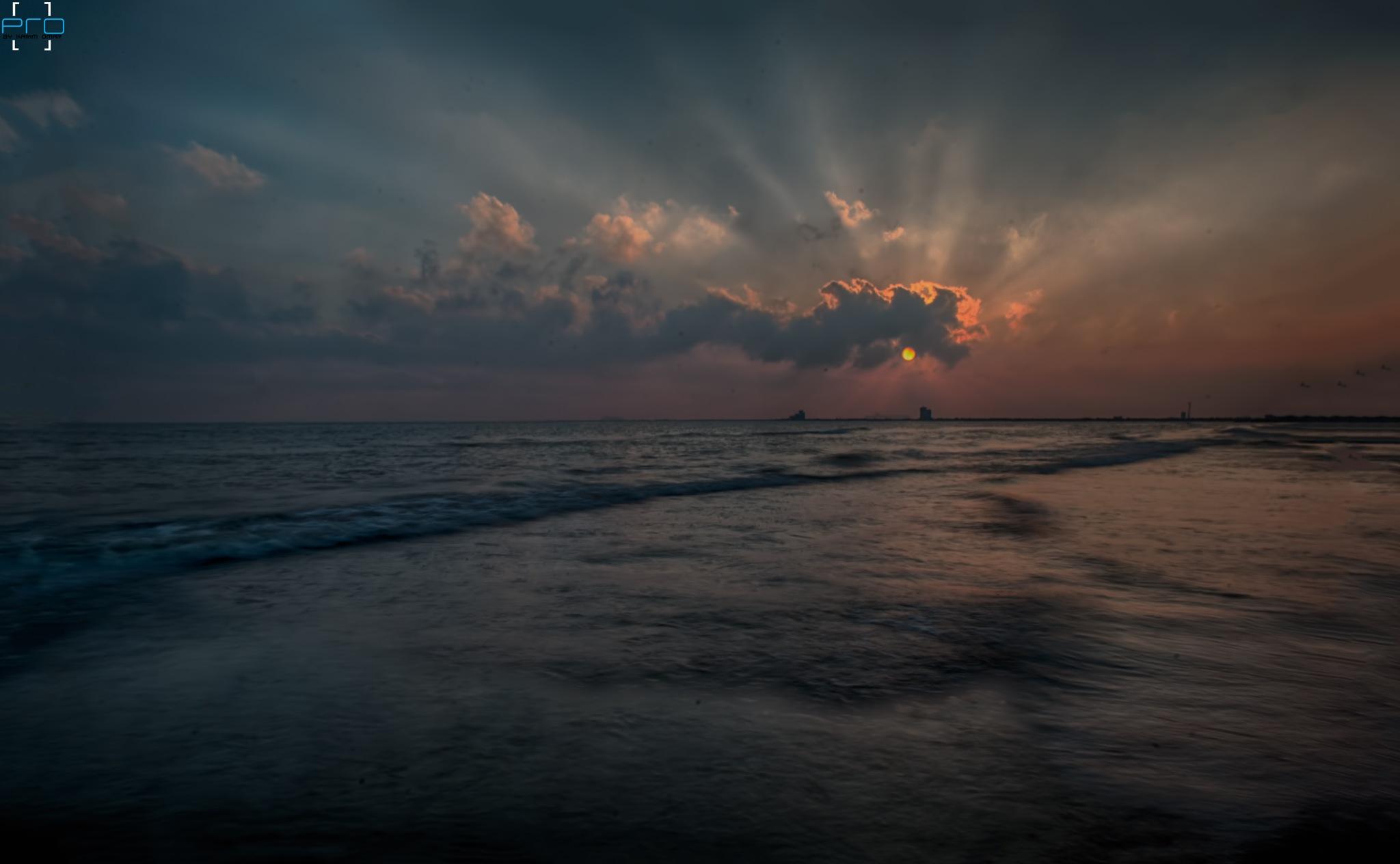 Behind the cloud  by Kareem Omar