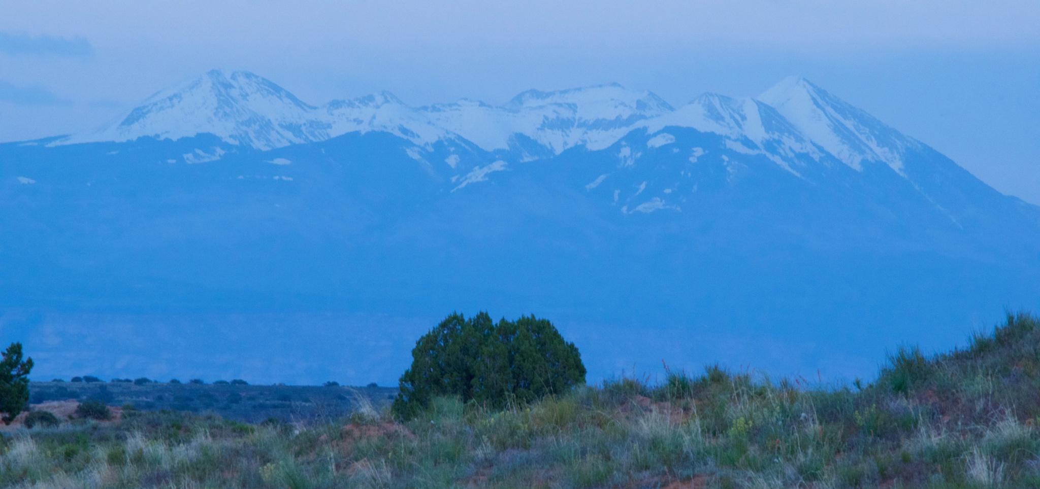 Lasal Mountains in evening twilight by John  Lepisto