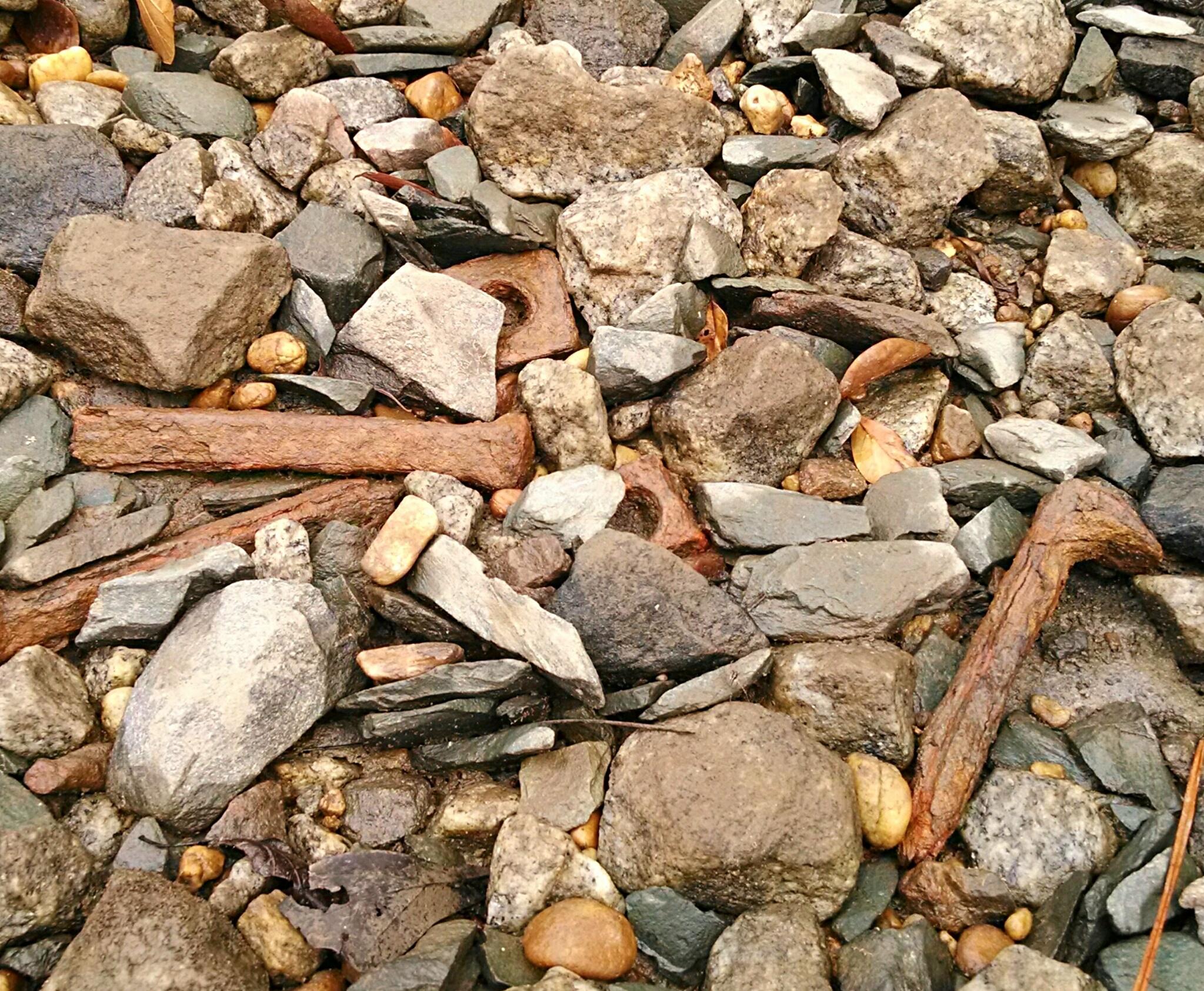 railroad stakes upon rocks by Angela Roark aka Raven Isaboe Wolfe