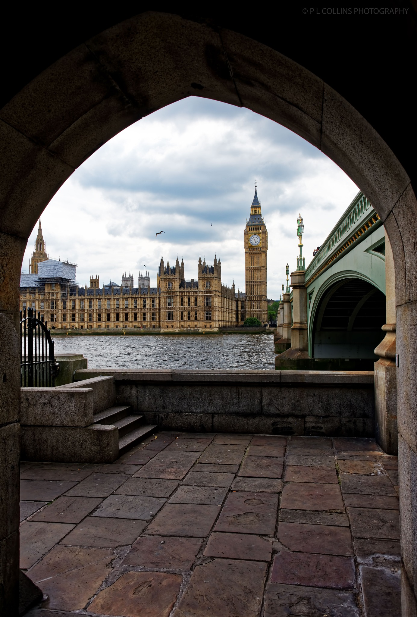 Big Ben framed in an archway by Paul Collins