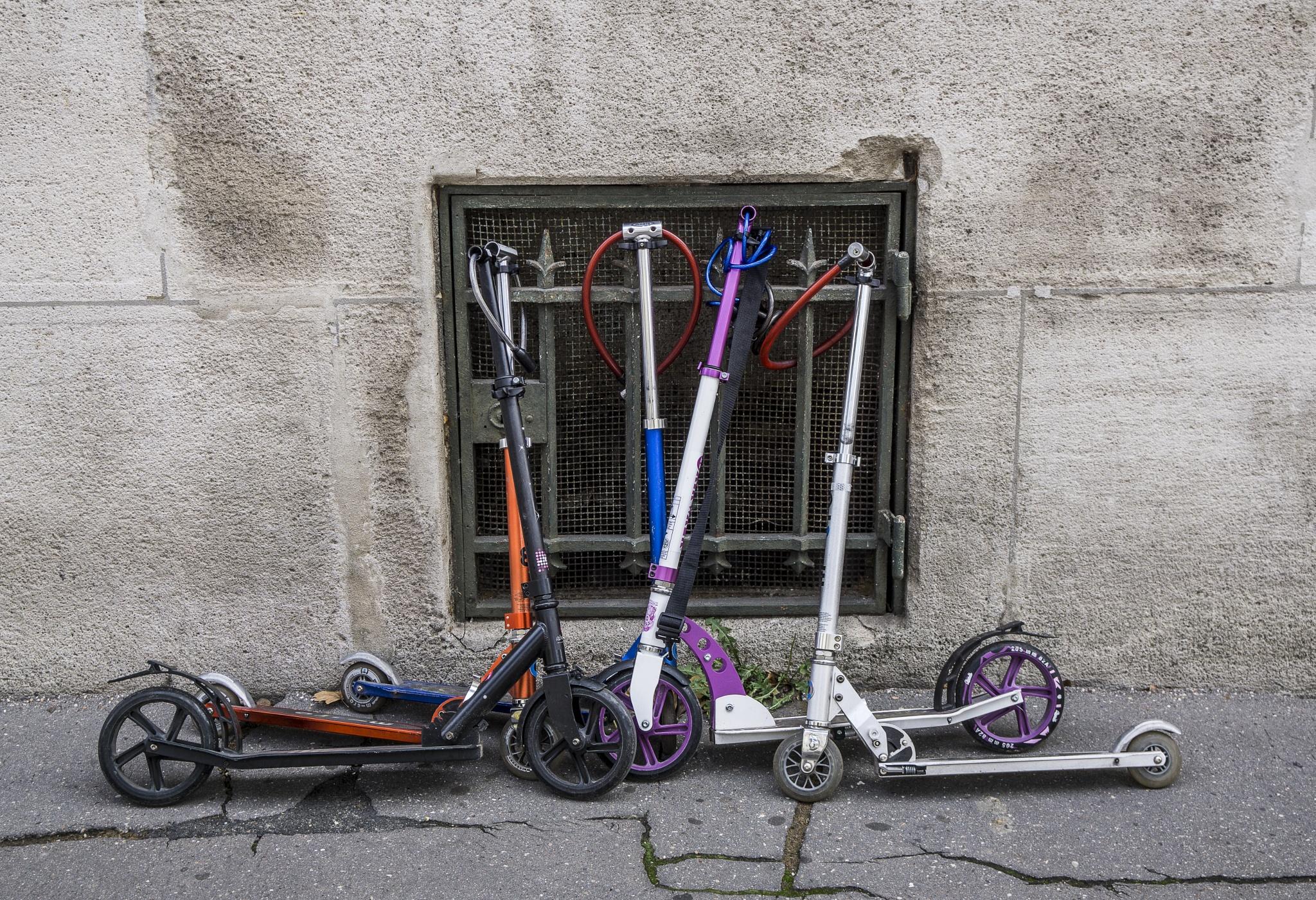 Scooters outside school, Paris by Chris Lane