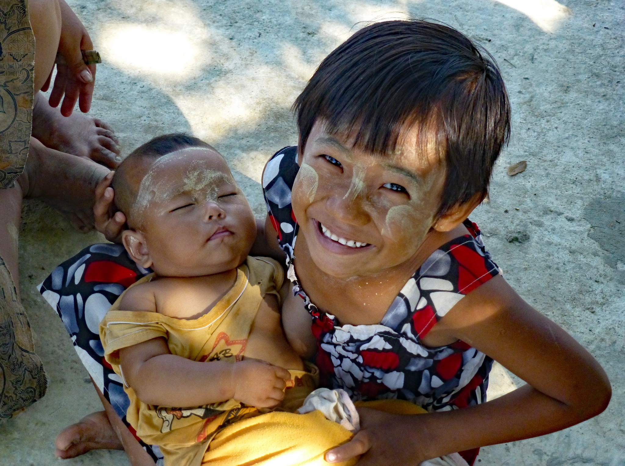 Burmese sister and baby brother by Frank Brande