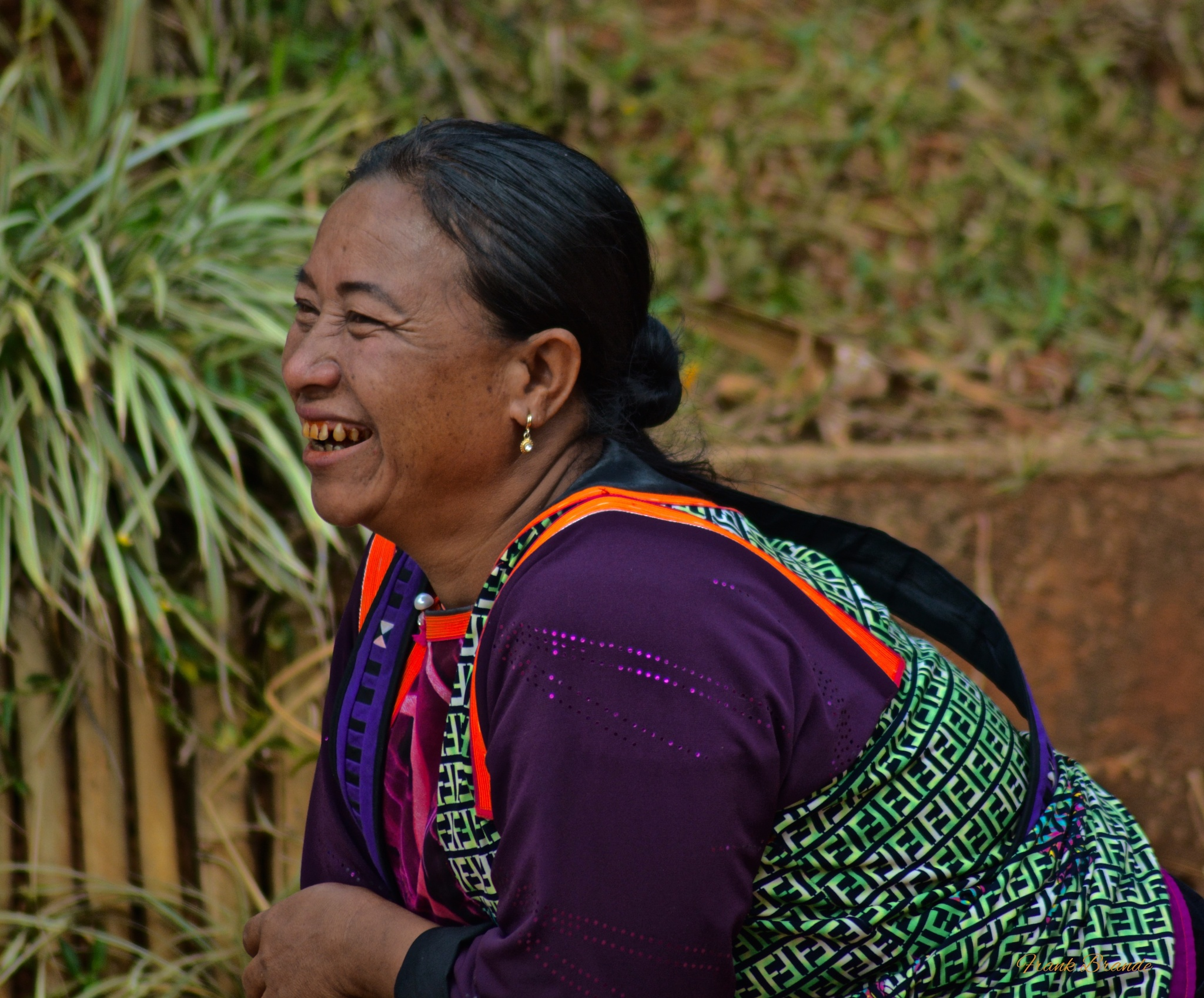 In the moment: Thai Hill Tribe woman watching her daughter play by Frank Brande