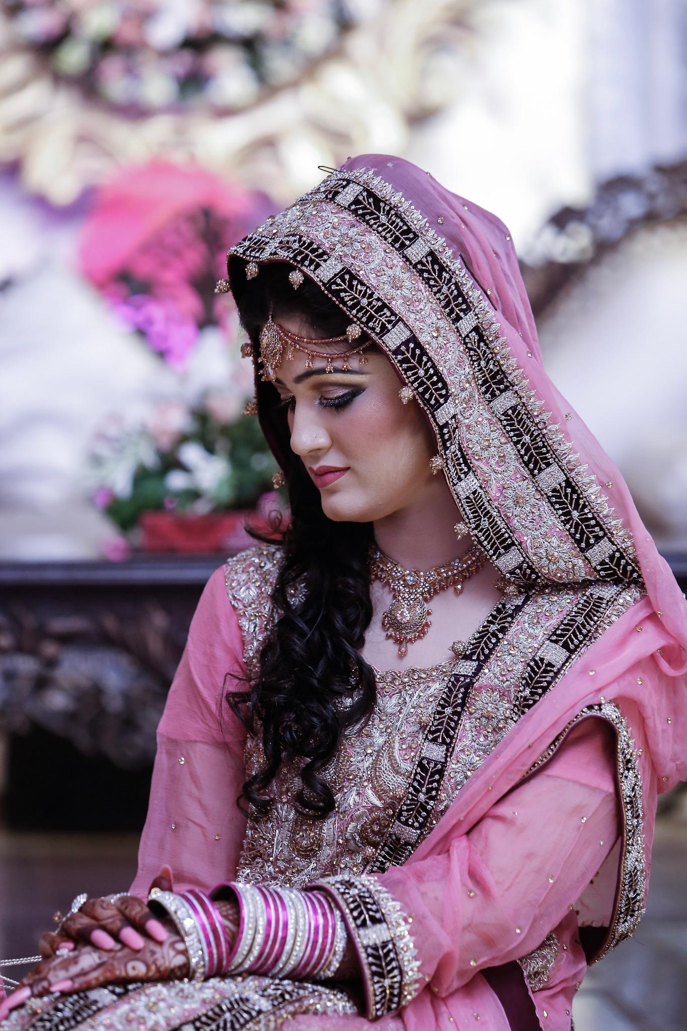 Bride in Pink by Sadat Ali