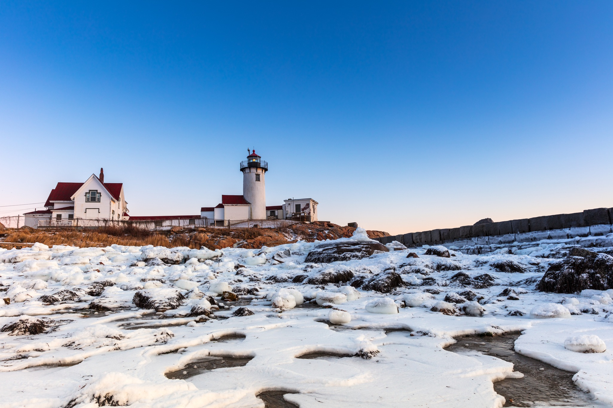 Lighthouse in the Snow by kpharney