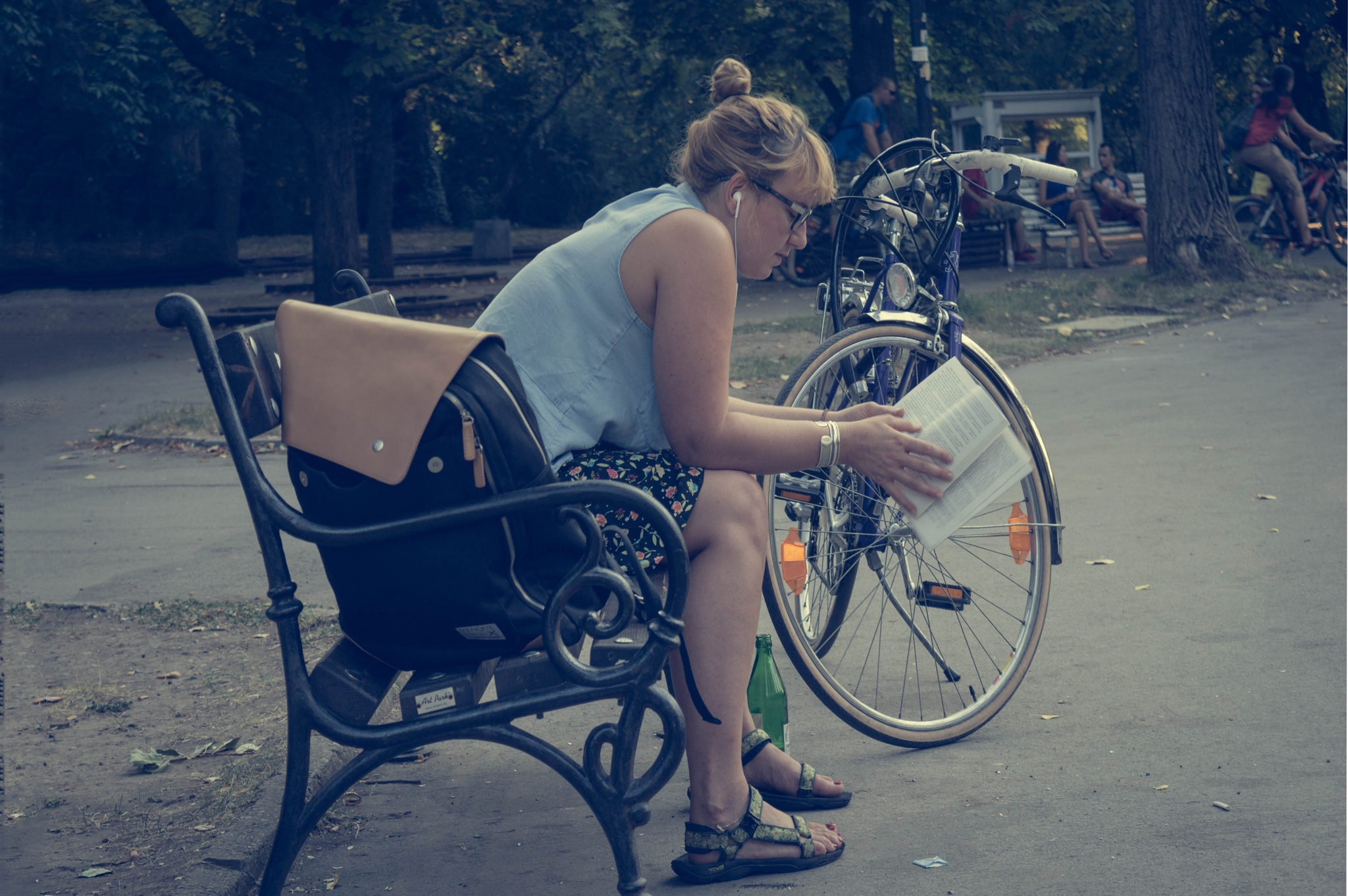 Woman reading book in park by Hristina Hristova