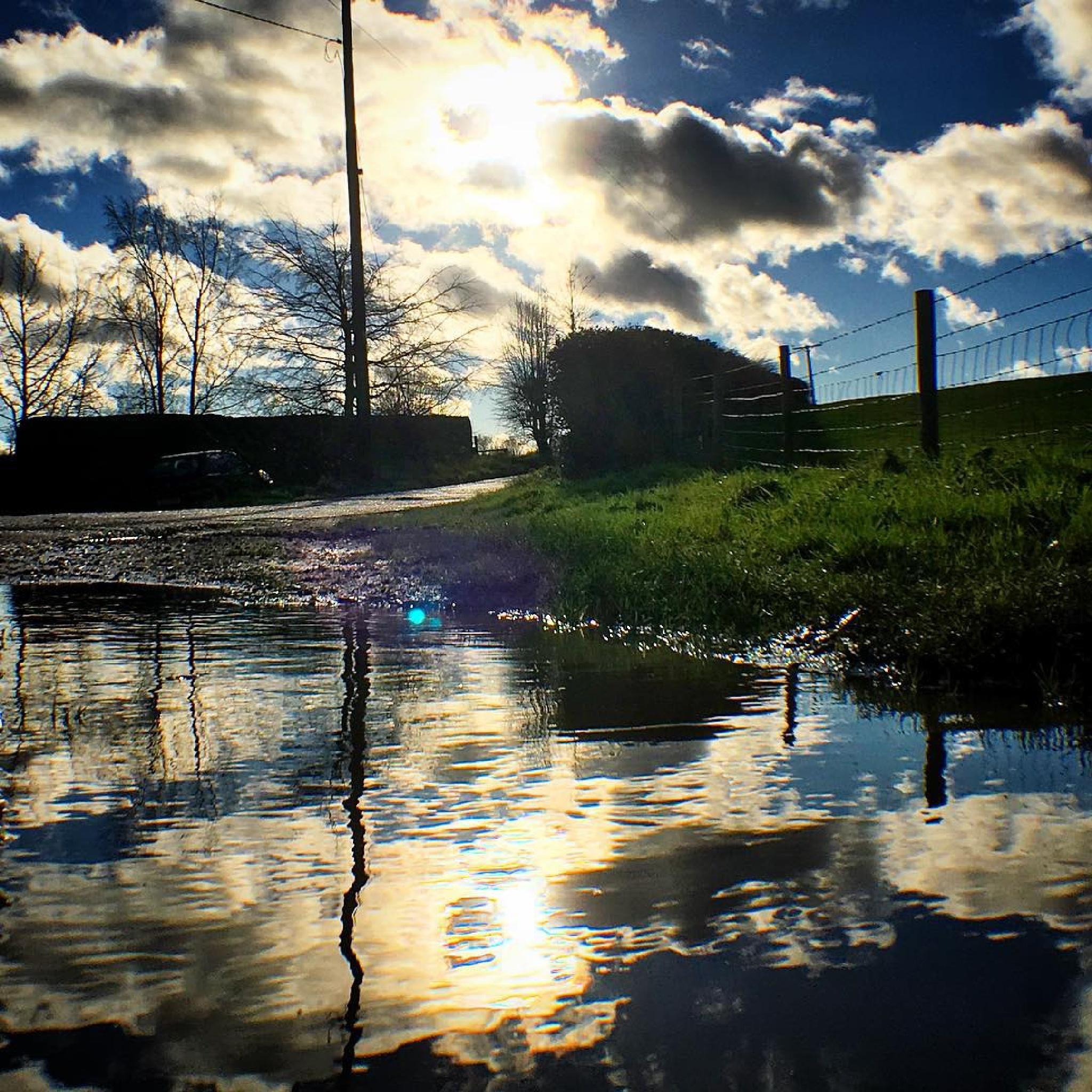 Winter sunshine breaking through clouds over Bramley farmland by beaniedee