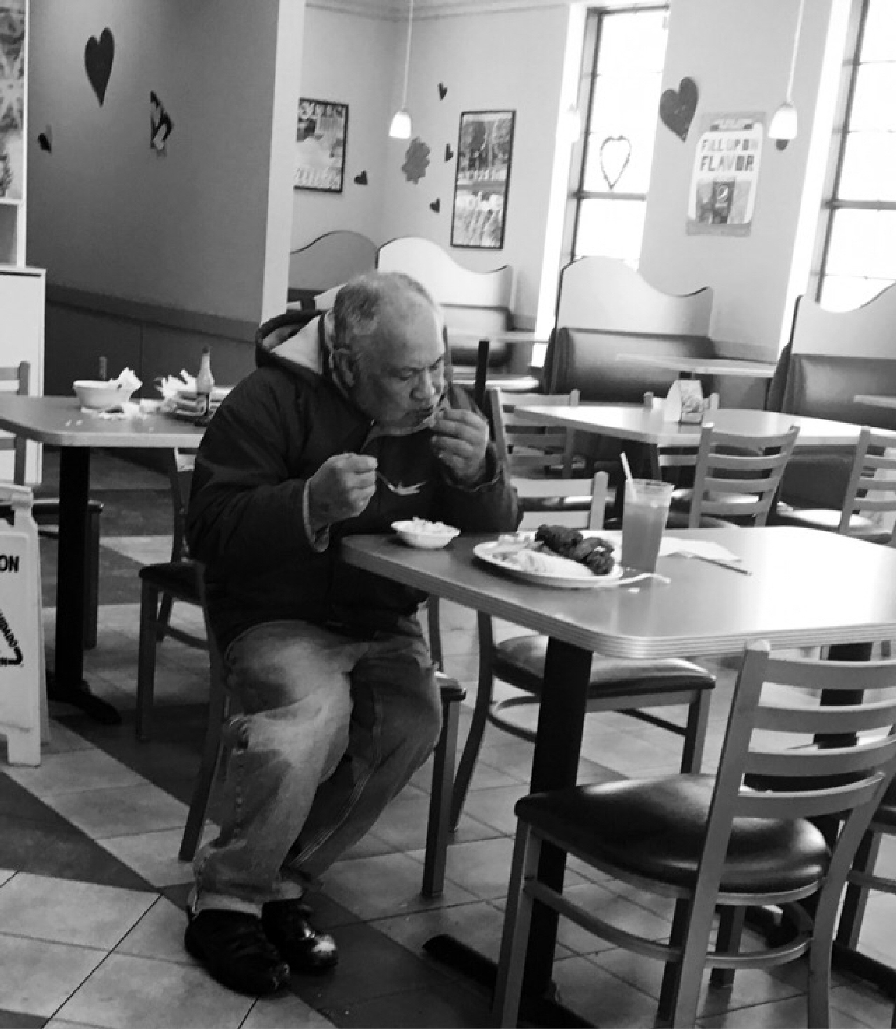 Man ejoying Food  by Edna Iris Rodriguez