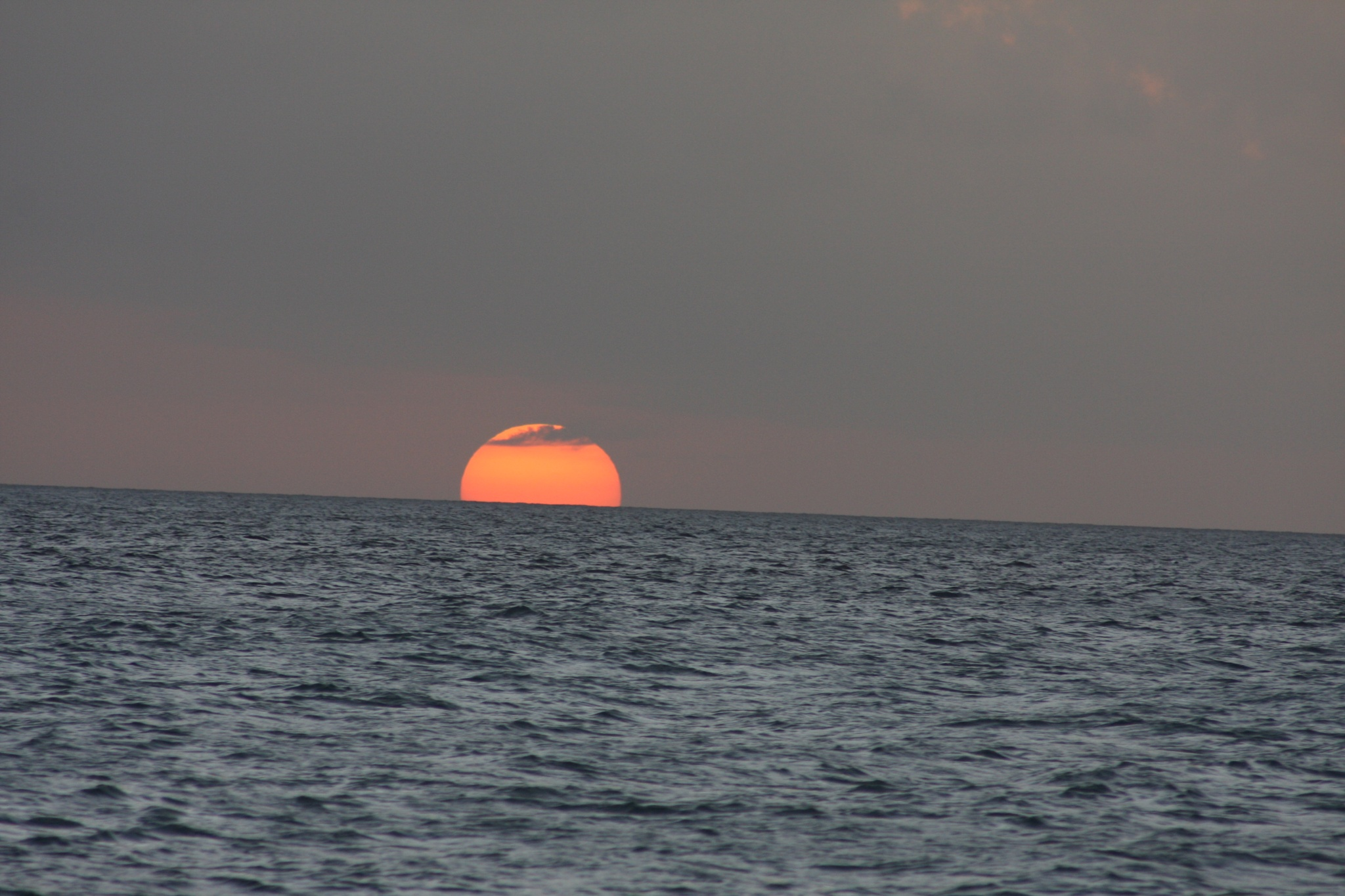 Sunset Into the ocean by Roger Sims