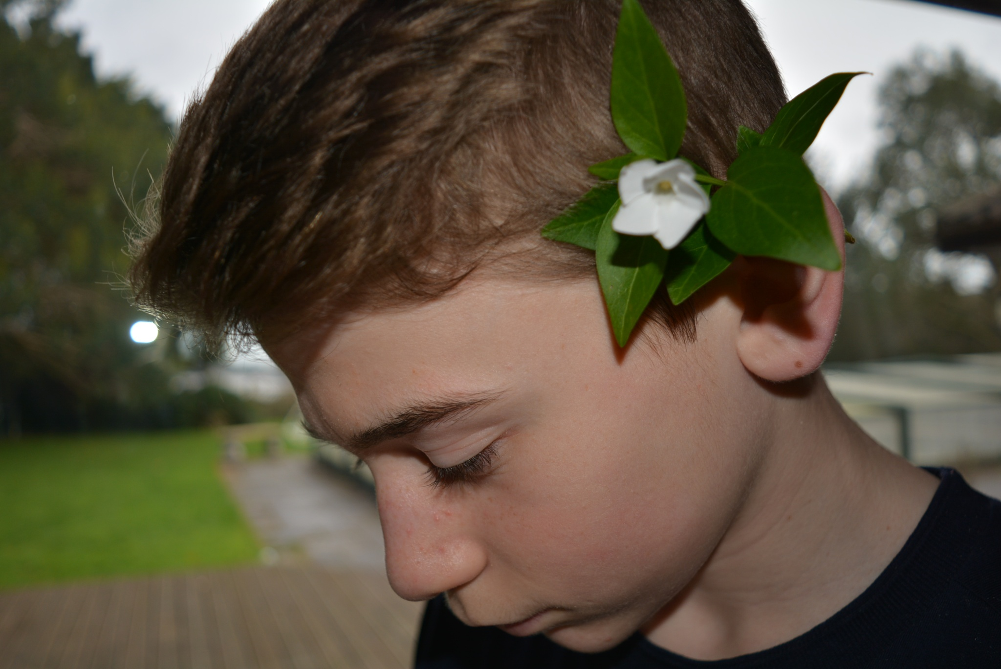 Little boy with flower in his hair by Talana_smith