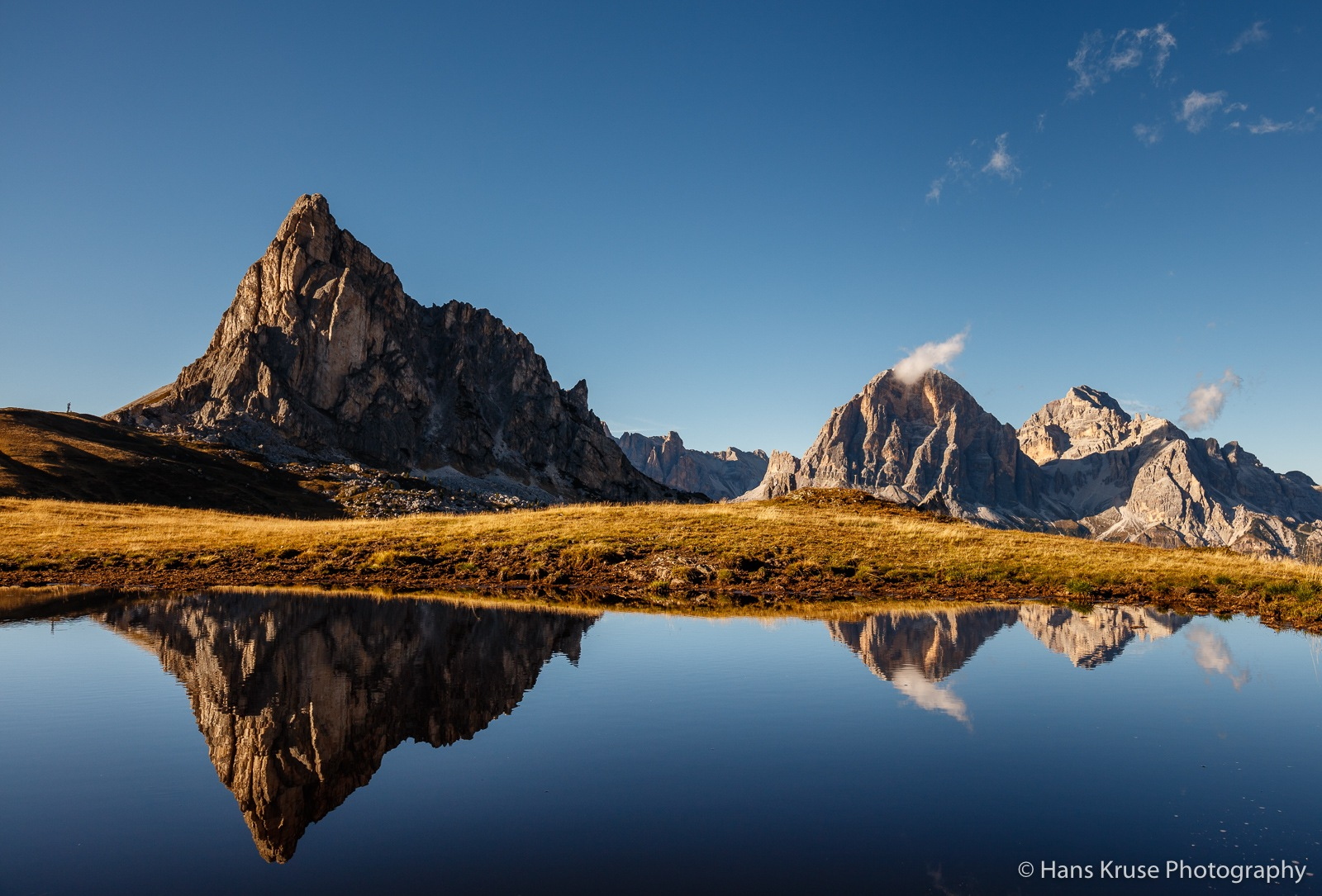 Reflection at Passo Giau by Hans Kruse