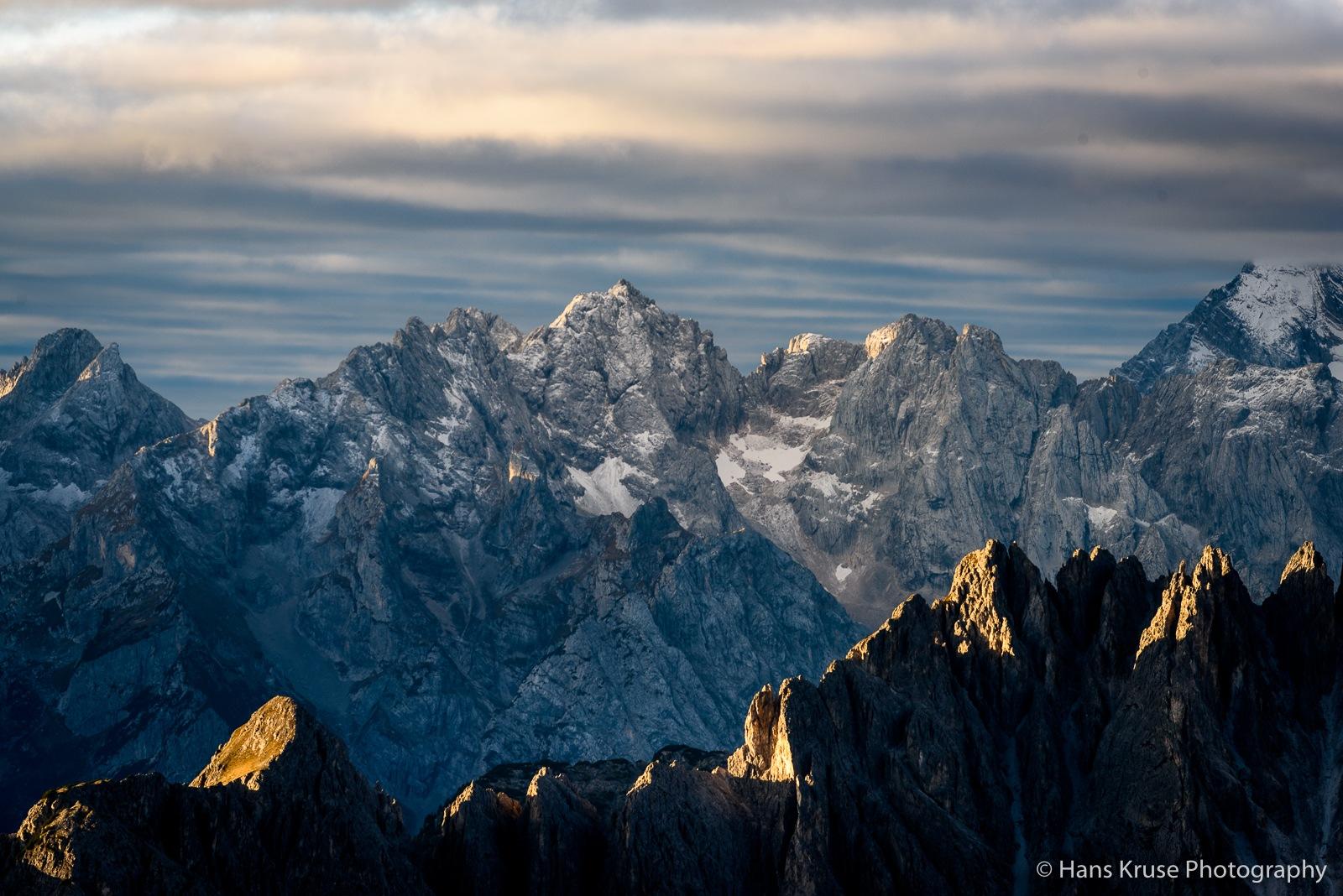 Morning light on the Cadini peaks by Hans Kruse