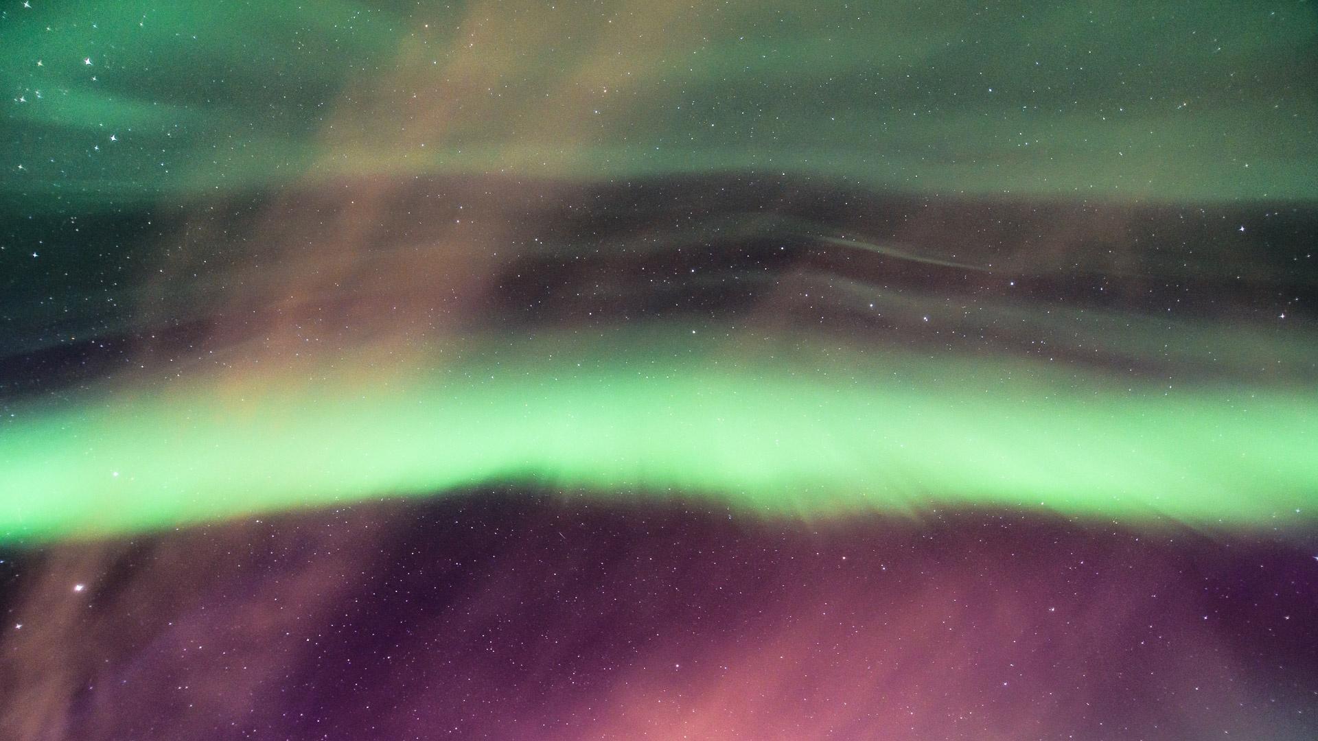 Aurora Borealis and Red Clouds by Veijo Härkönen