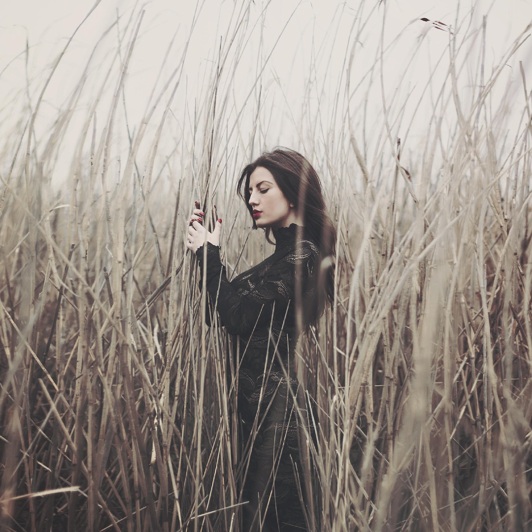 Girl in a field by Jovana Rikalo