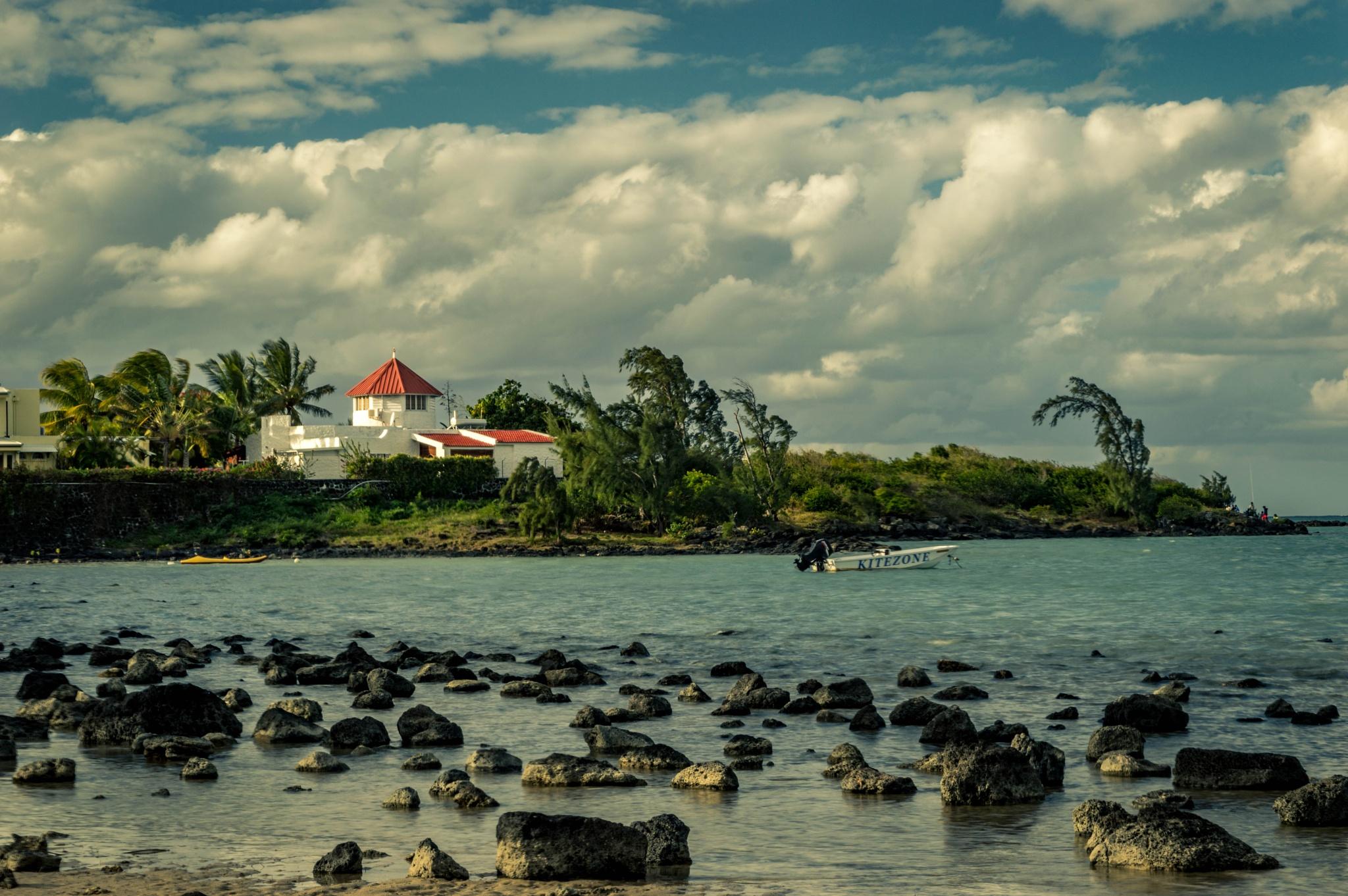 Photo in Sea and Sand #sea #boat #clouds #mauritius #landscape