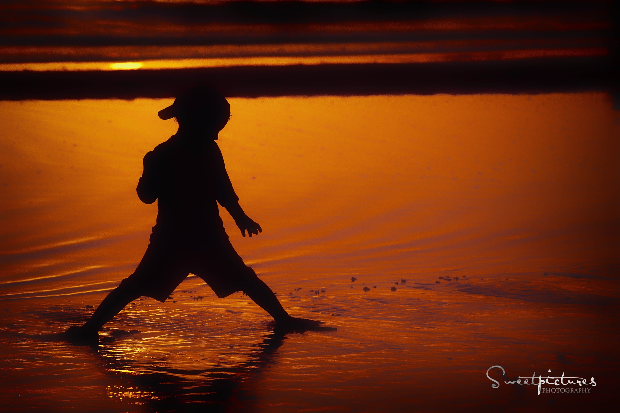 Boy in sunset by Anja Jost