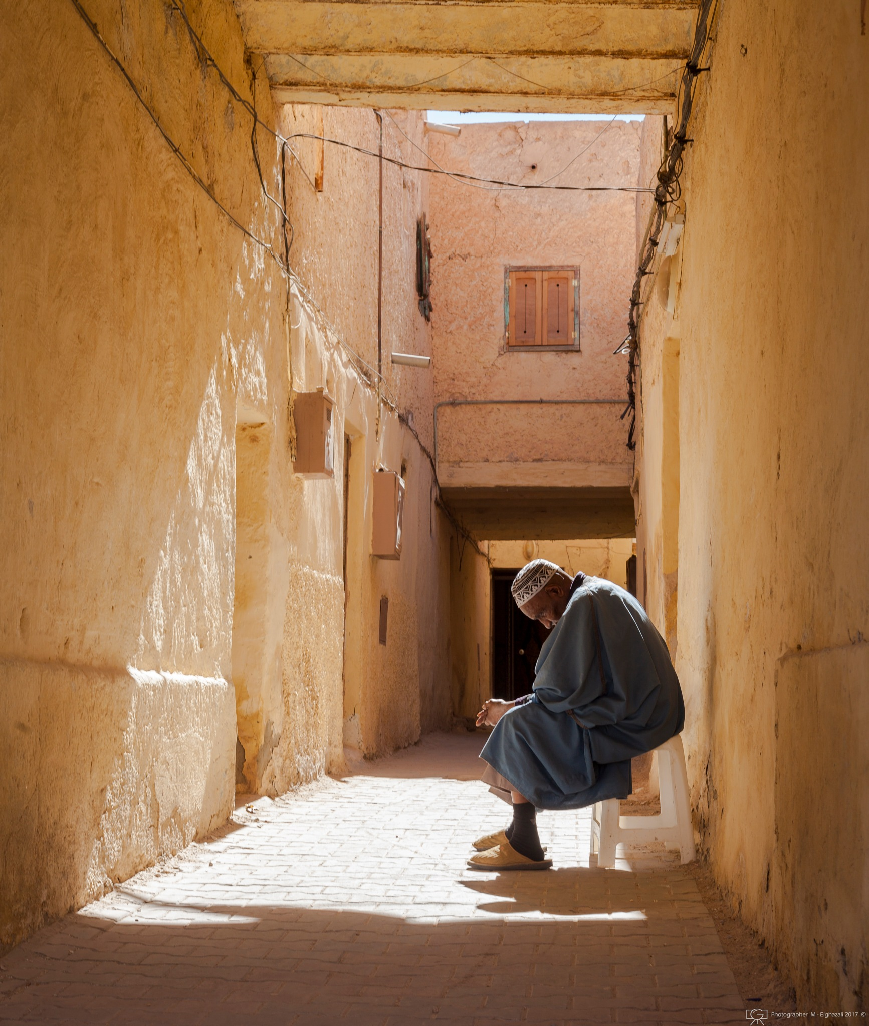 Old man in Old Building  by Merzaki Mohammed Elghazali
