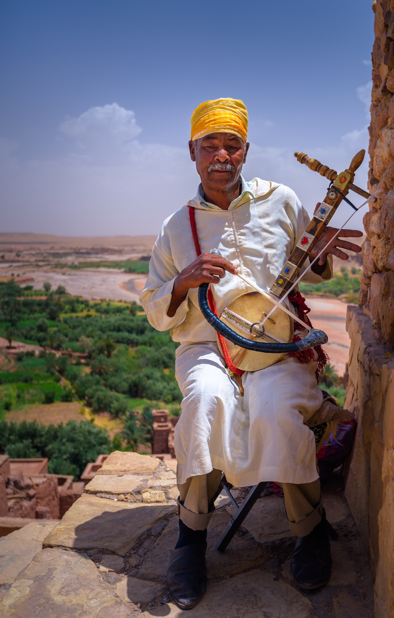 The Street Musician of Ait Benhaddou by Zouhair Lhaloui