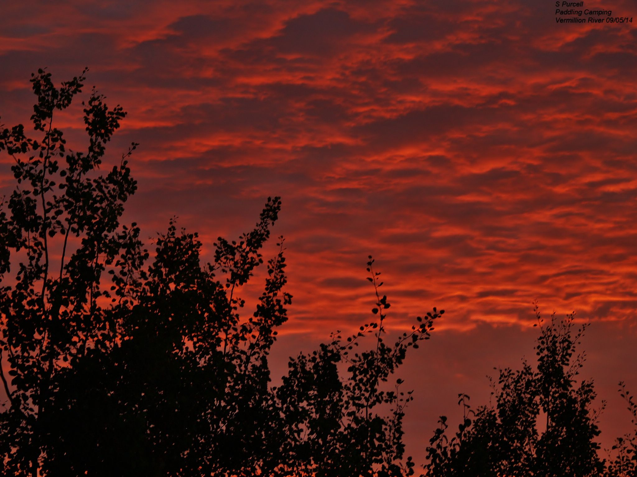 Under a Vermillion River sky by Sean Purcell