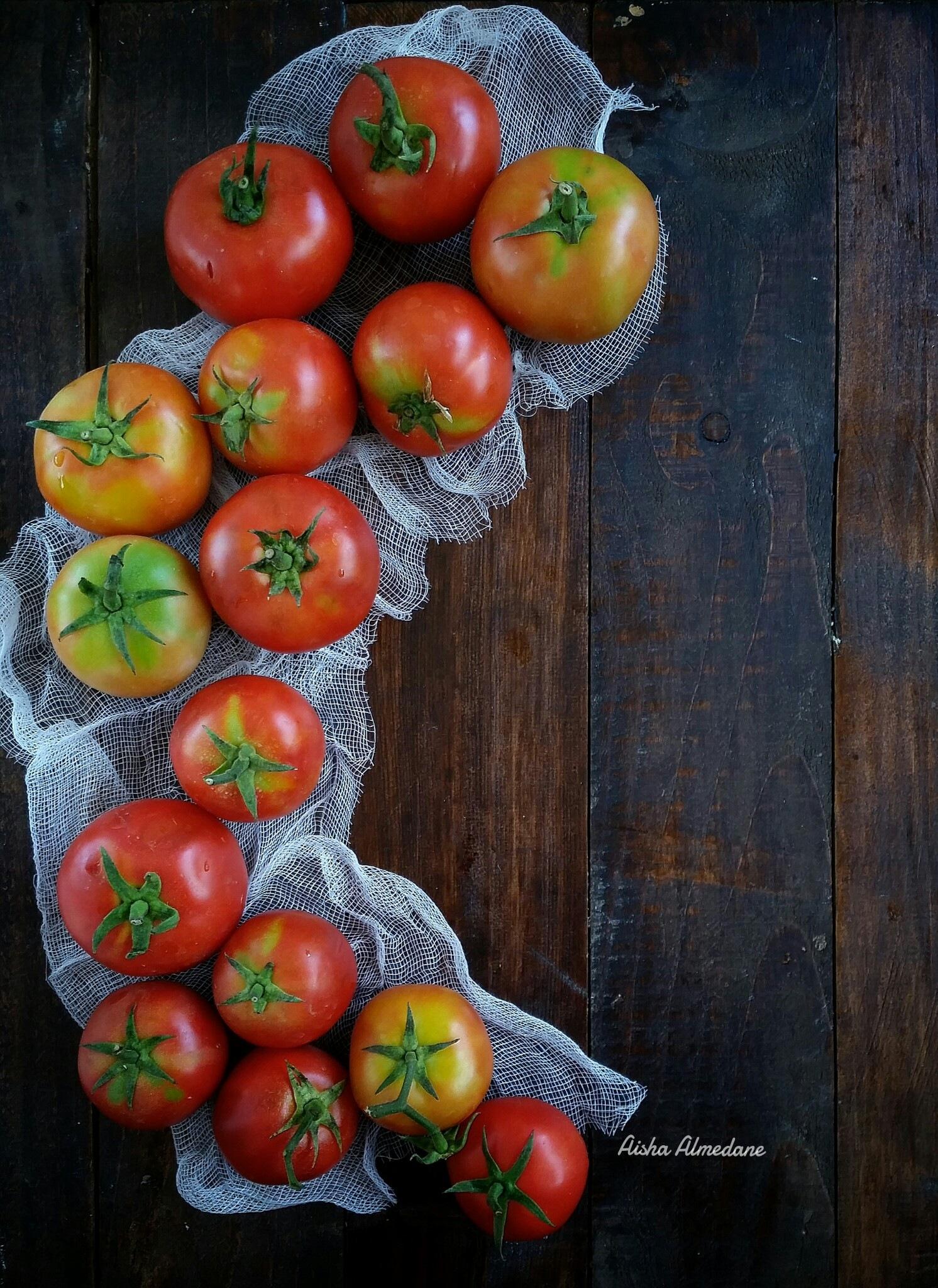 tomatoes  by Aisha Almedane