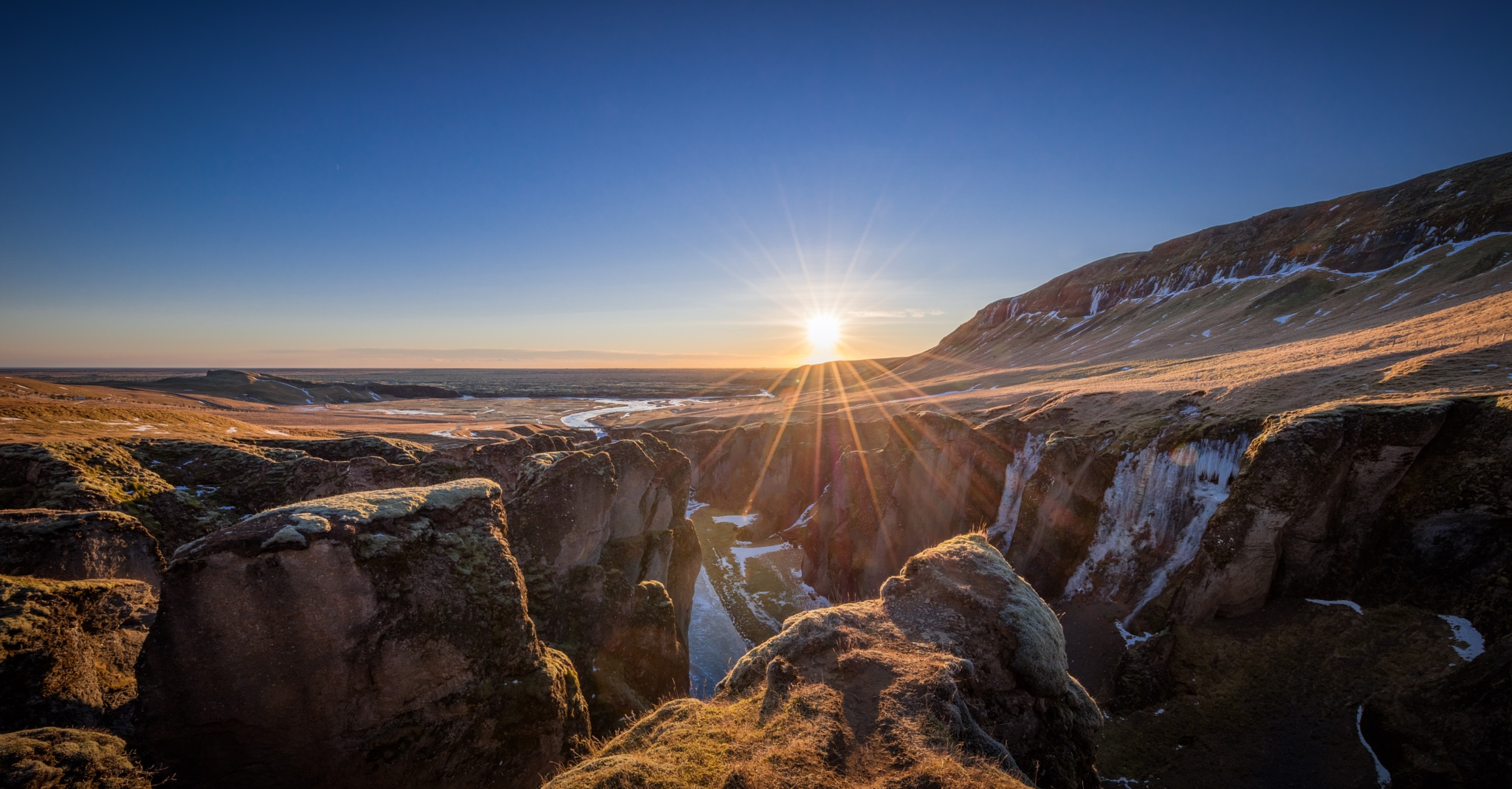 Photo in Landscape #iceland #ice #snow #winter #sun #canyon #fjaðrárgljúfur