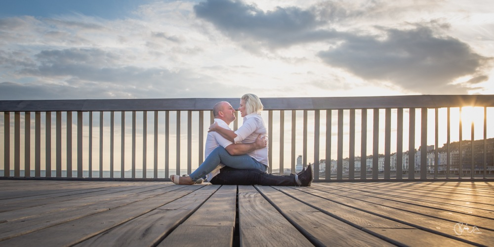 Engaged Hastings' couple rock  by Ebourneimages