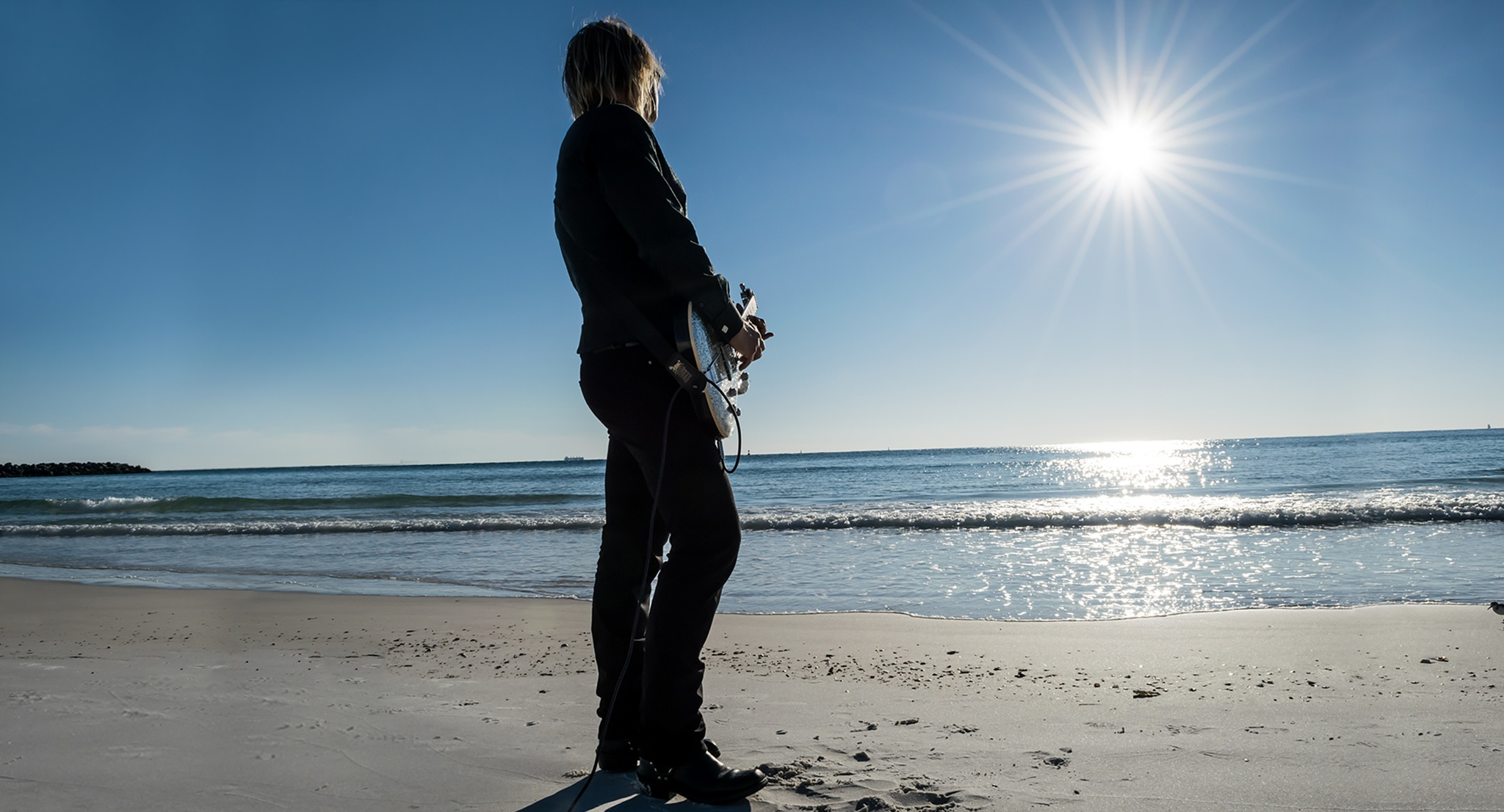 A Man With His Guitar On The Beach by TheHilaryClark