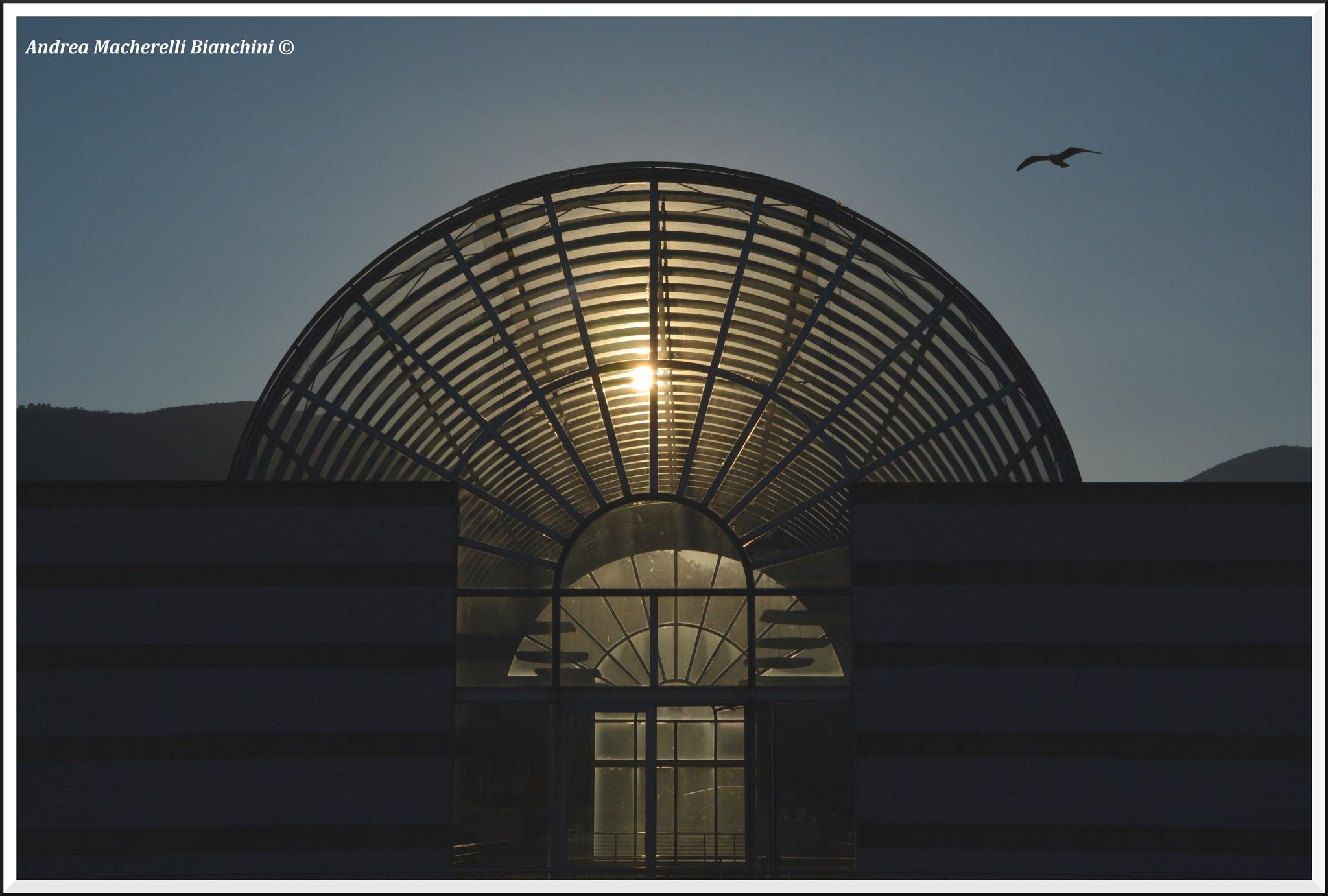 Photo in Urban #la spezia #liguria #ligurian region #italia #italy #gallery #sunset #sun #symmetry #light #sky #urban #exploration #urban exploration #structure #building #glass #blue #dusk #evening #ray #rays