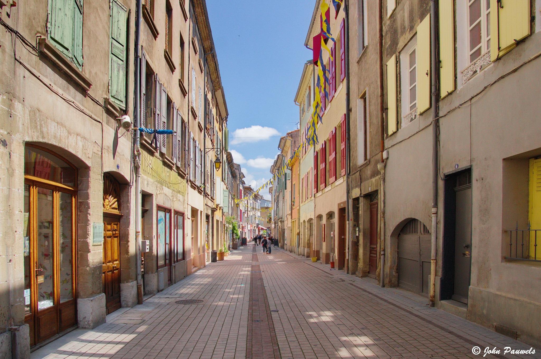 Colorful street. by John Pauwels