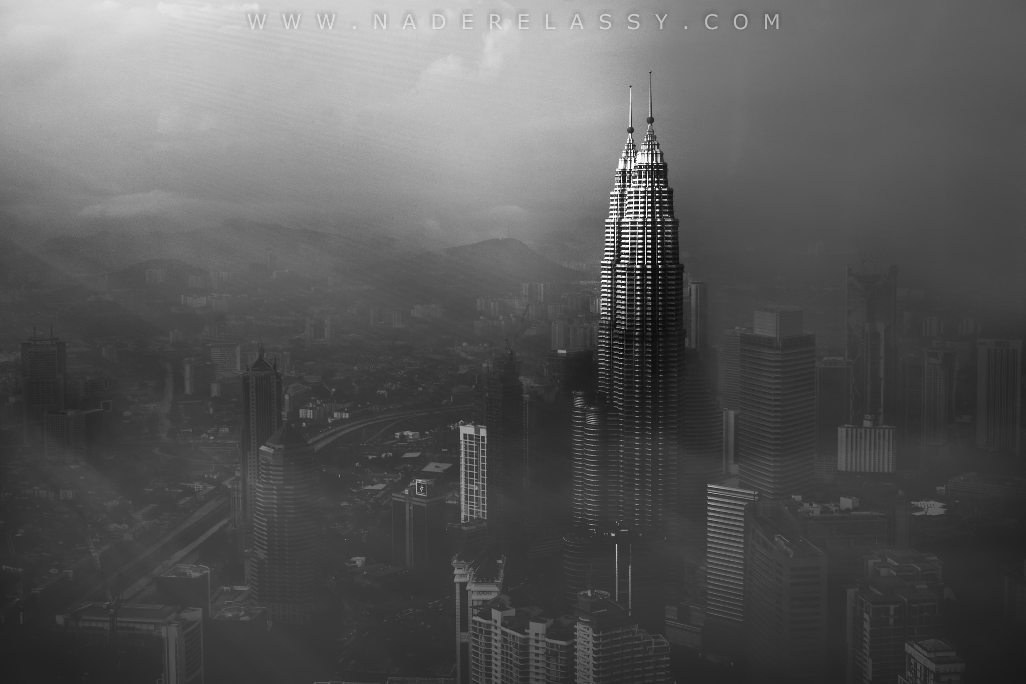 Petronas Towers in a Foggy Afternoon by Nader El Assy