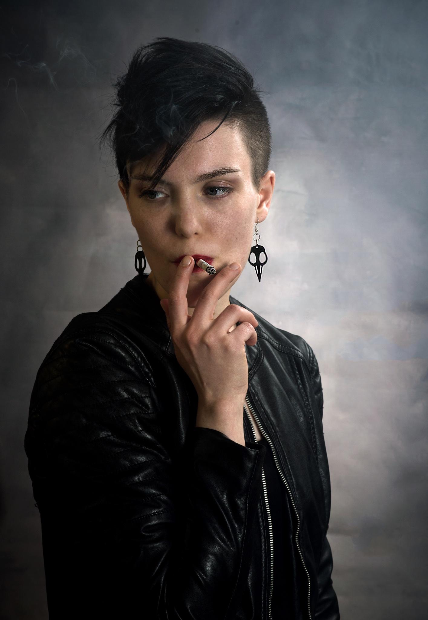 Having a cigarette by Veli-Matti Launio