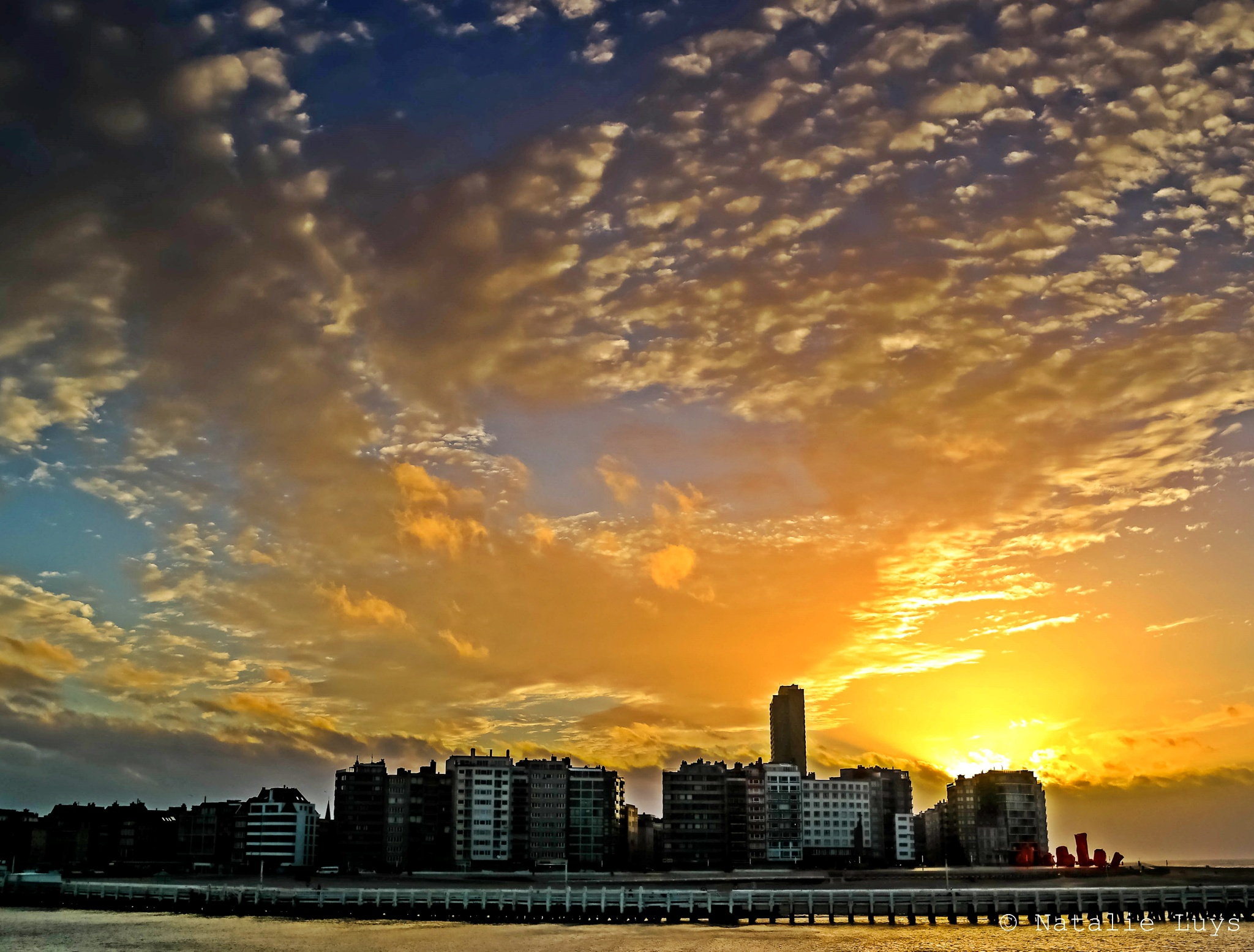SUNSET OVER THE CITY by Natalie Luys