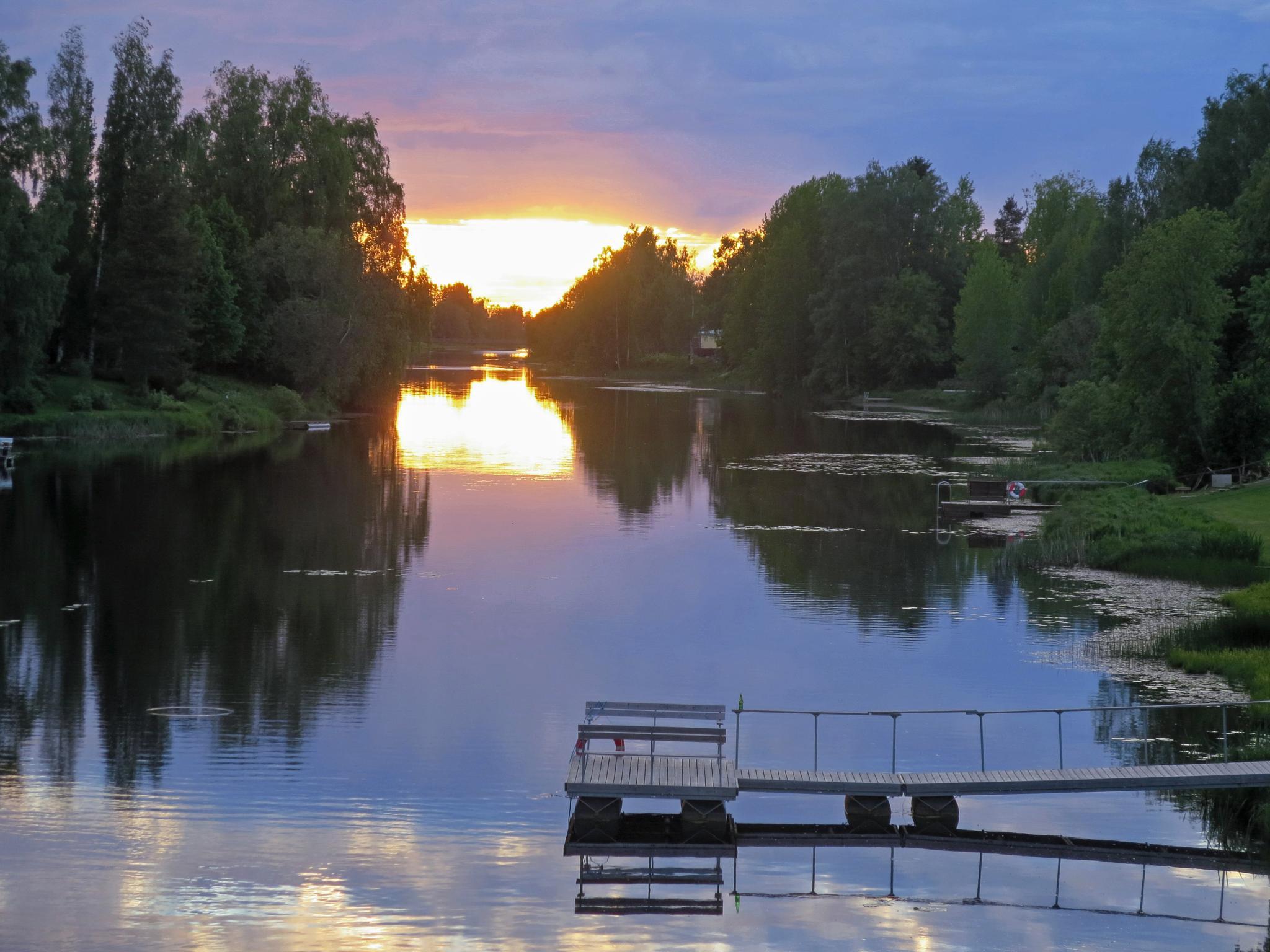 Midsummer lights on Finnish riverside by evasojahannele