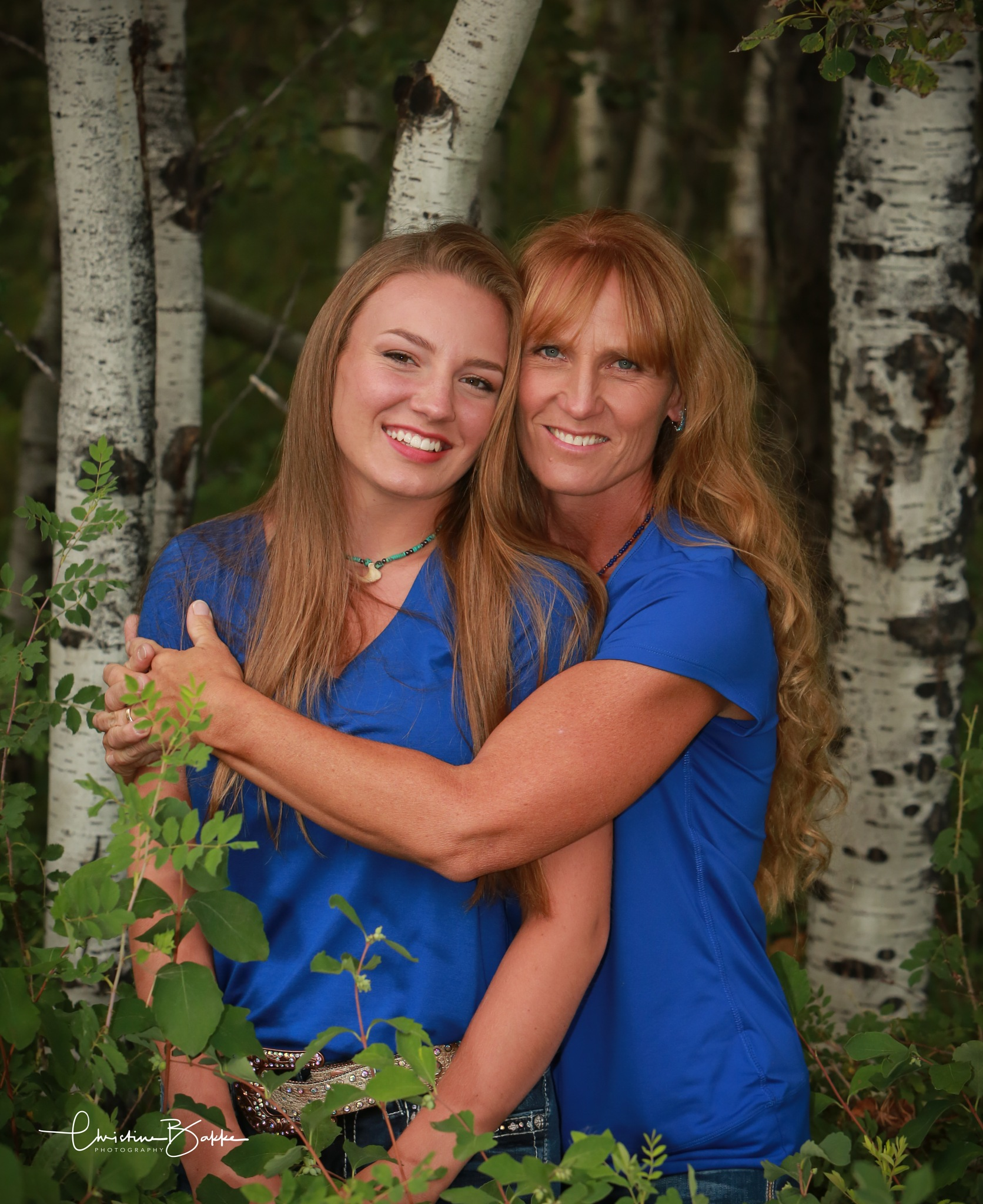 Pretty mama and daughter by Christine Bakke