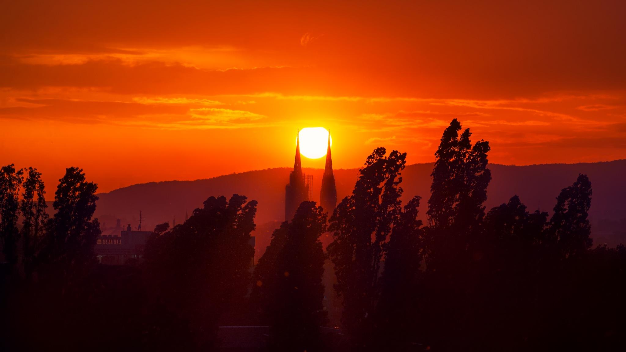 Sunset between belfries by IvanVucetic