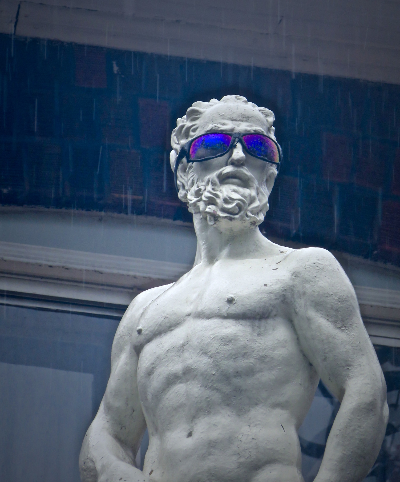 statue man always looks cool in all kinds of rather inclement weather  by David Devion