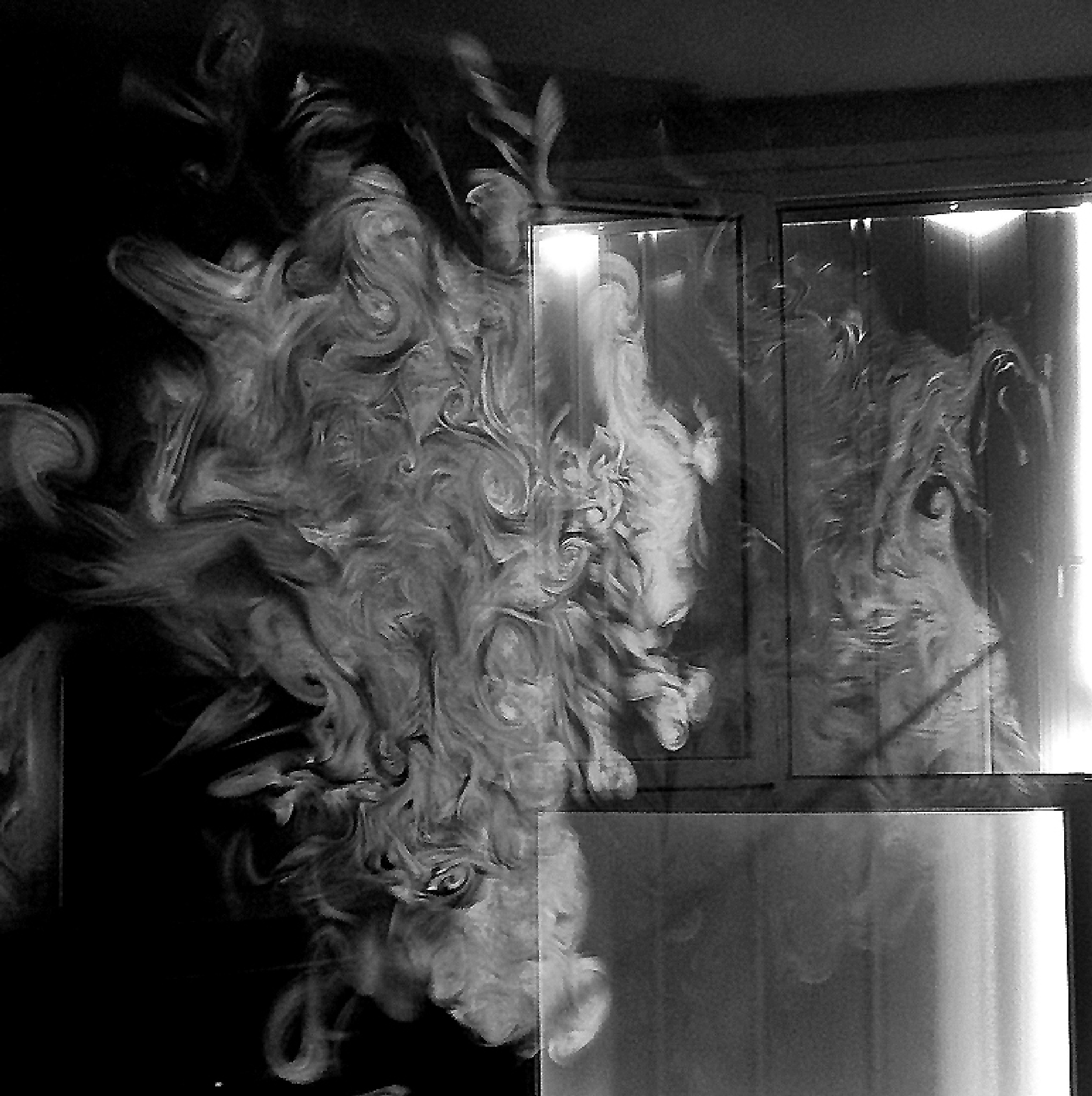 The Face at the window. Tobacco Smoke heading for Fresh Air. France.  by Malcolm White