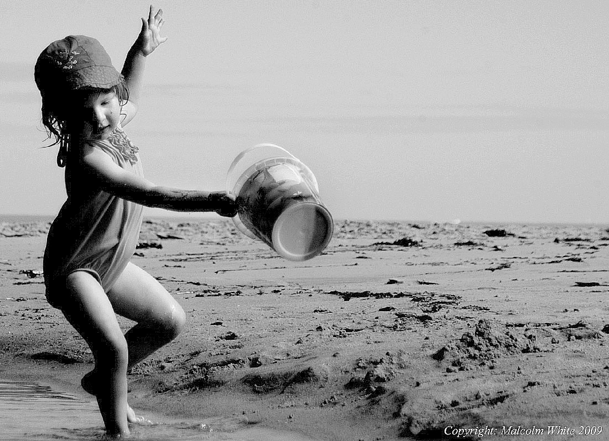 Girl and Bucket. France. by Malcolm White