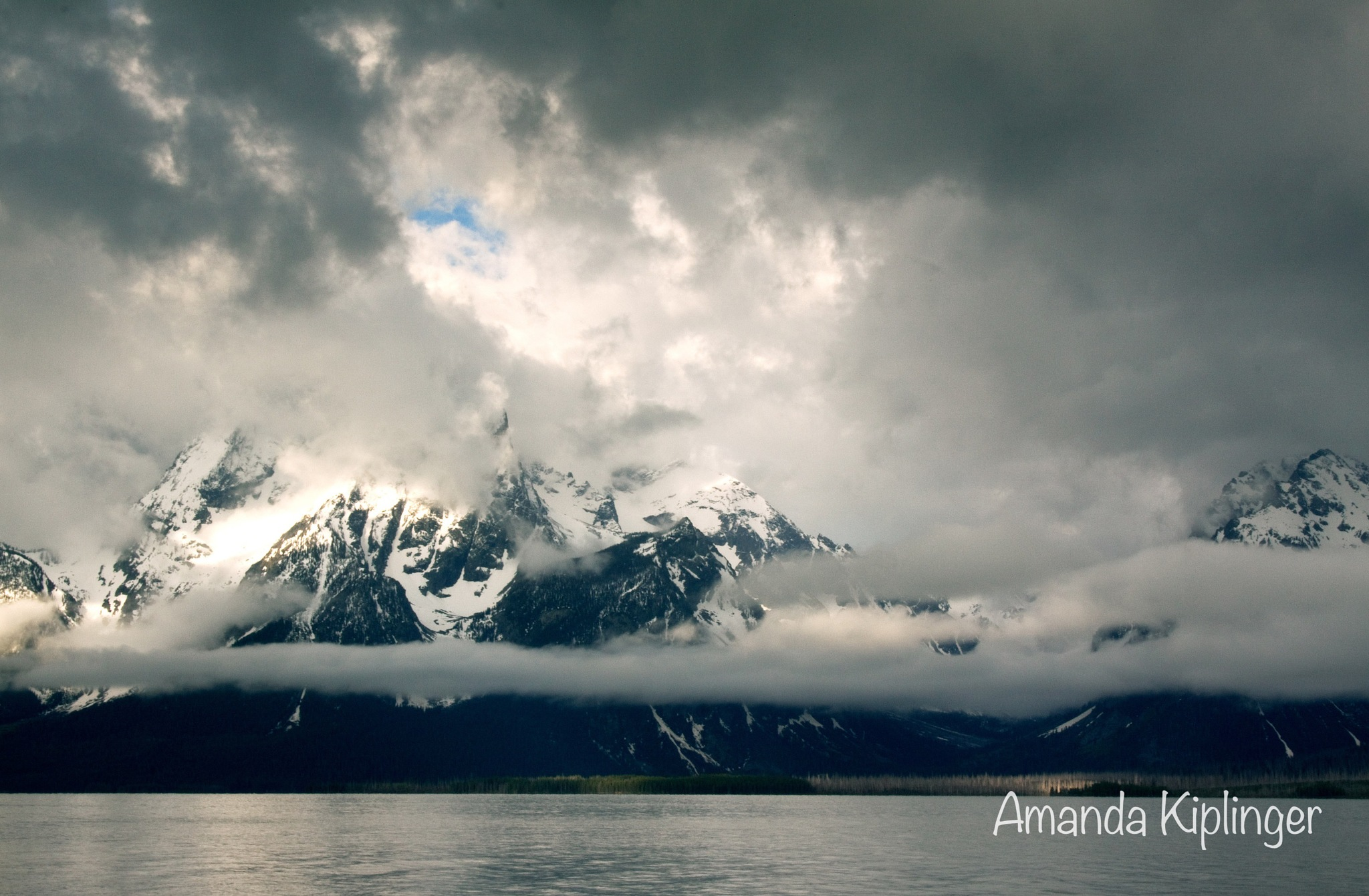 Blue Sky Trying to Poke Through Clouds by Amanda Kiplinger