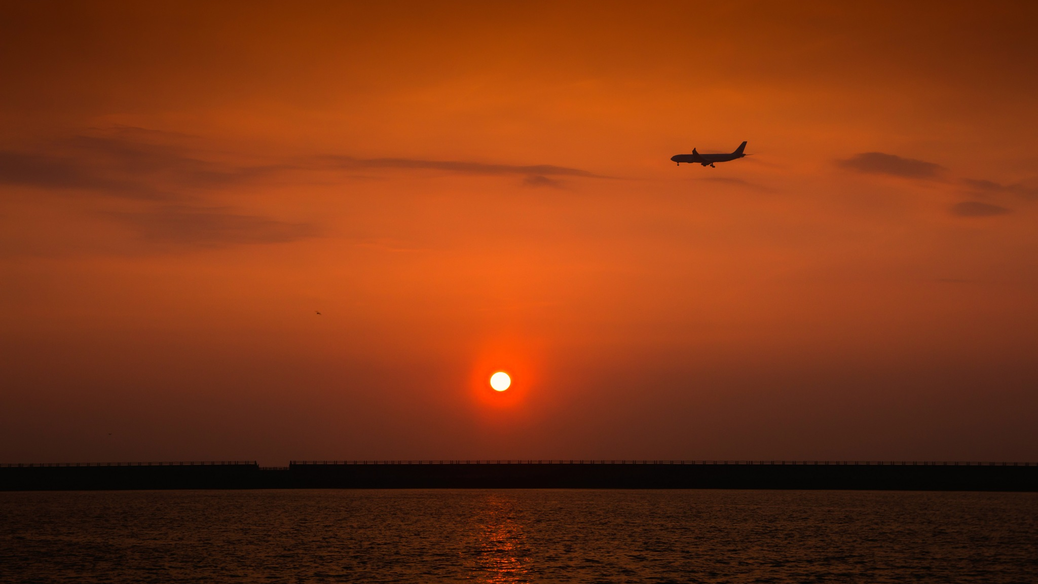 Sunset and Landing airplane by gorkhe1980