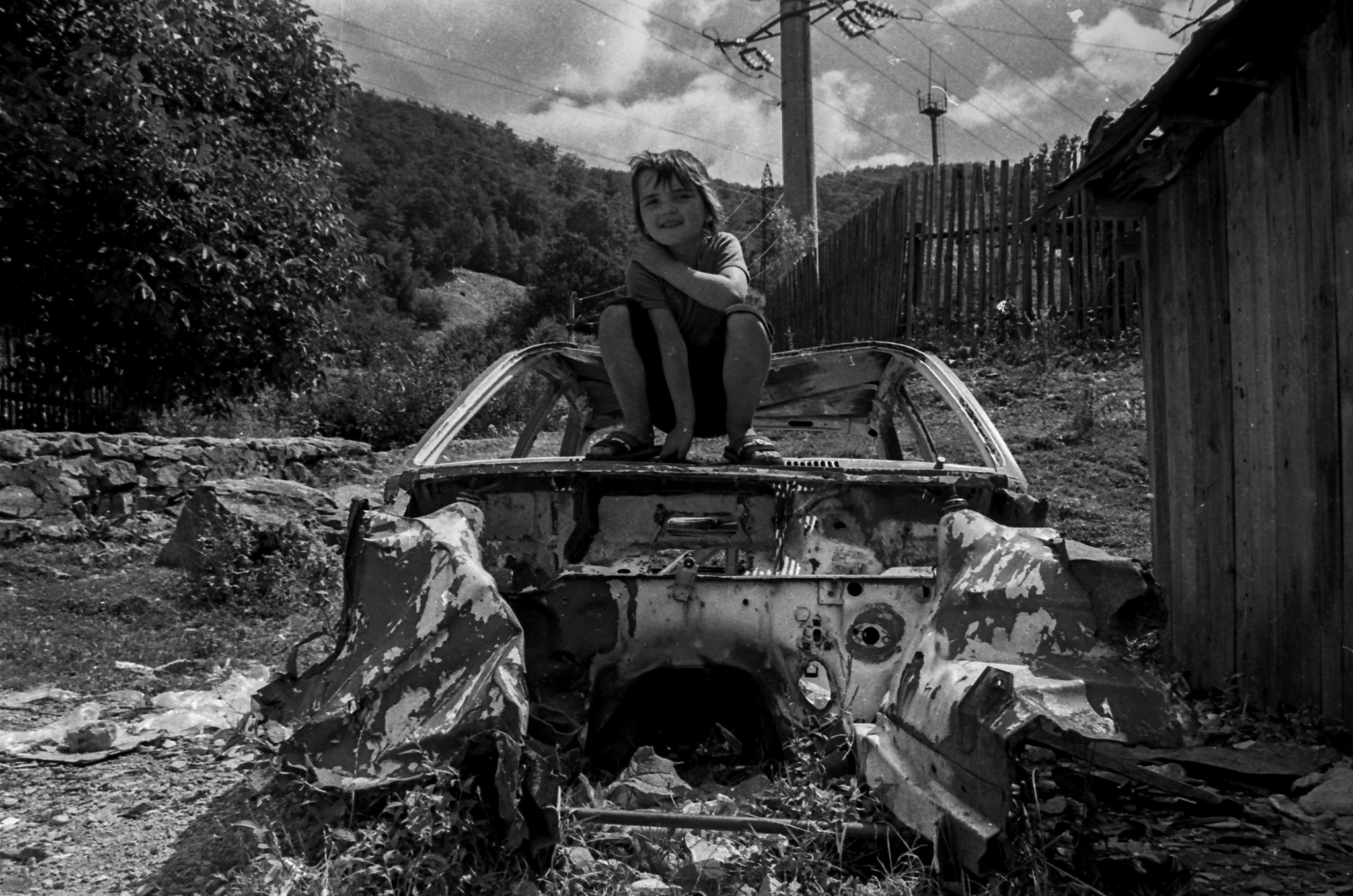 Photo in Black and White #girl #kid #wreck #car #film #35mm
