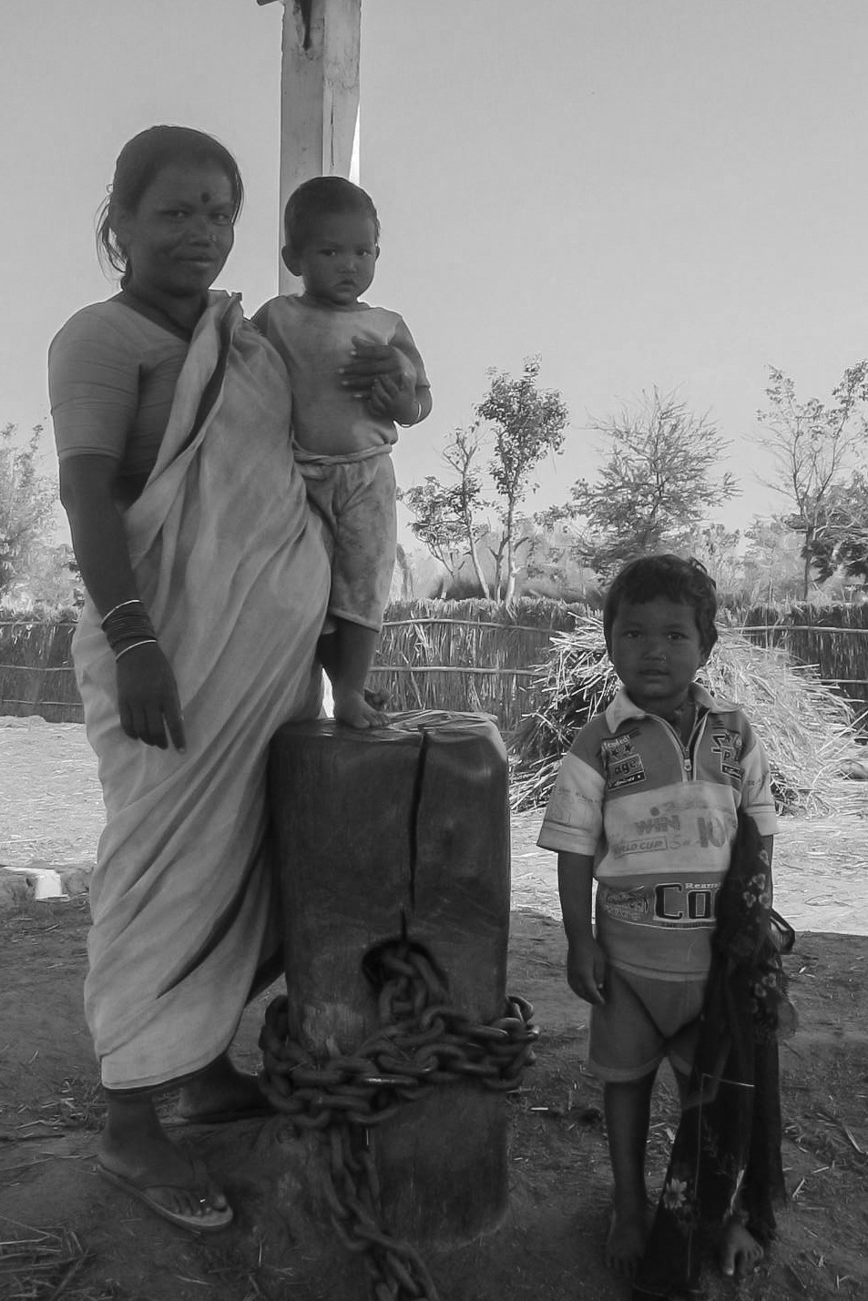 Mother with children in the nepalese countryside. by Harleybroker
