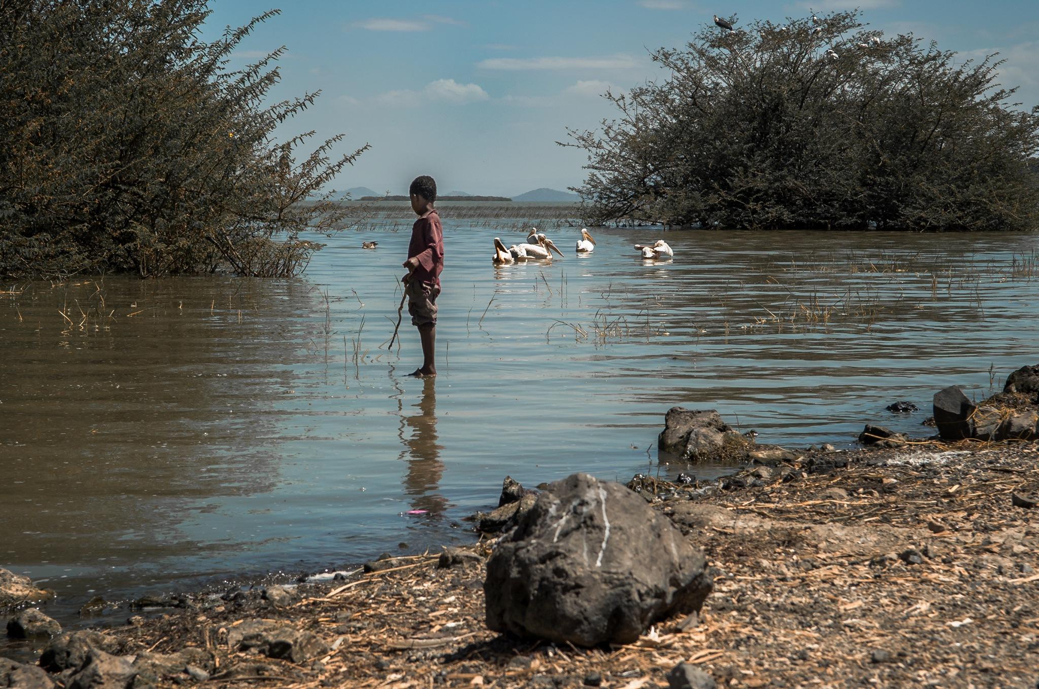 """Boy fishing in Chamo Lake"" by Juan Mas-Bagá"