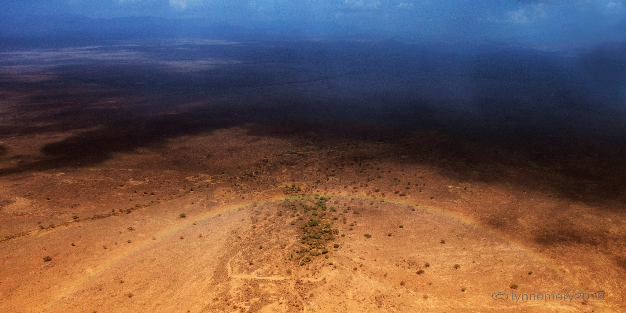 the rains in Africa meet somewhere over the rainbow by Lynn Emery