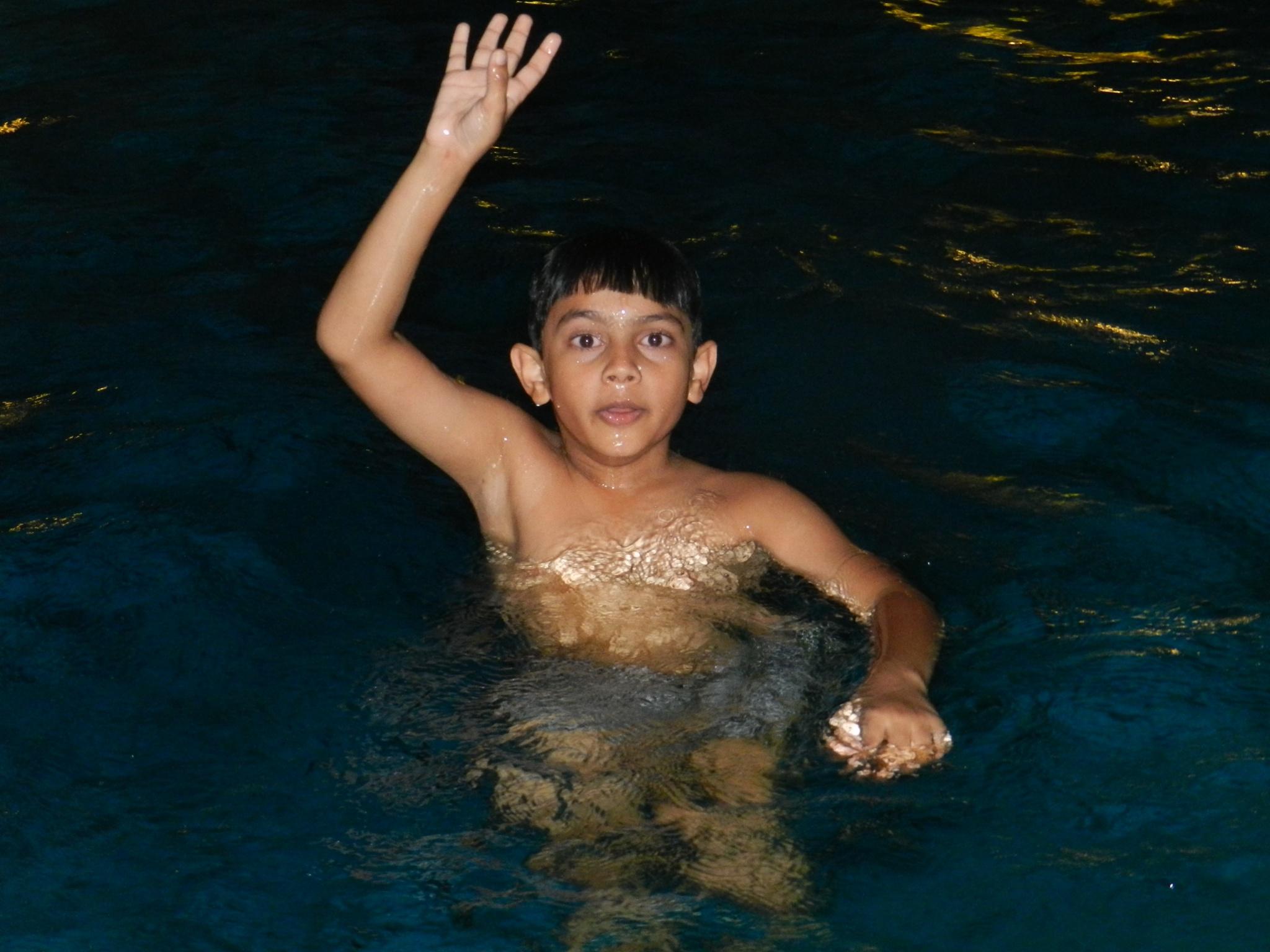 Funtime in pool by Shrenik Dodhia