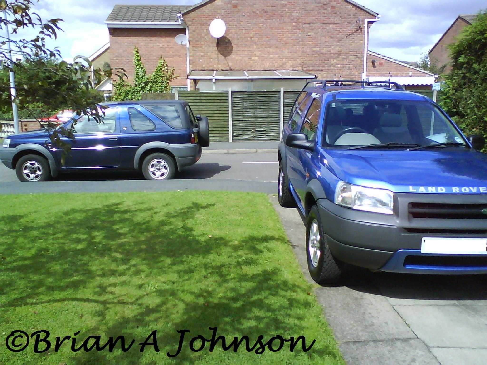 Land Rovers in the sun by Brian Johnson
