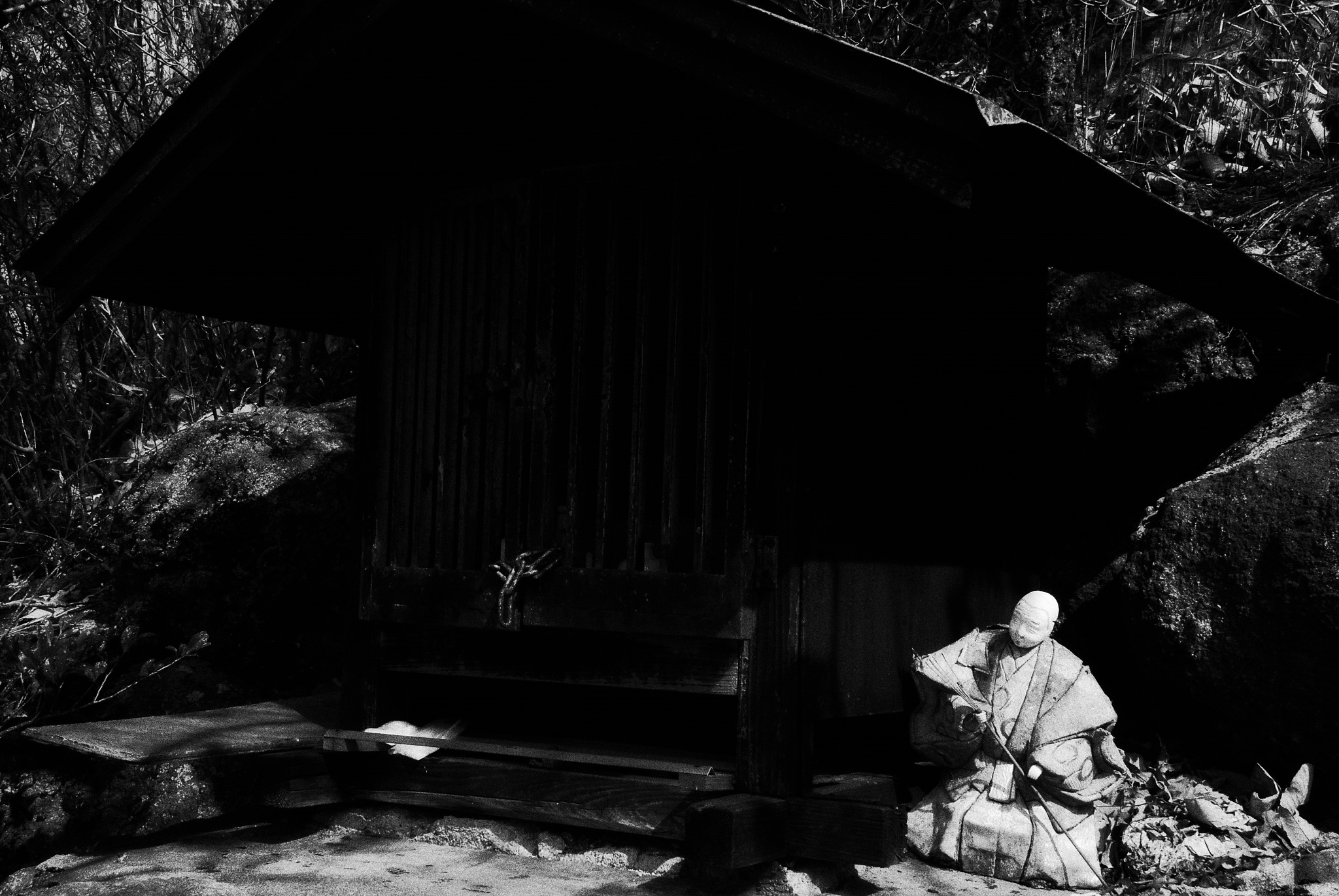 Photo in Black and White #monochrome #black and white #light and shadow #small shrine #japanese doll #abstract #japan #osaka #mountain