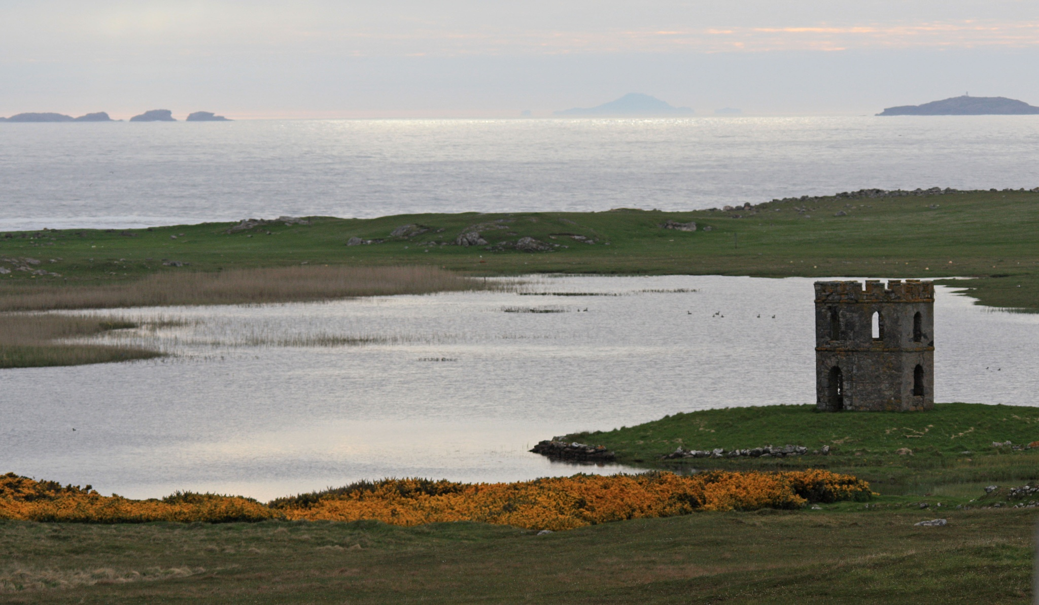 Scolpaig Tower, Isle of North Uist with St. Kilda in back ground by Theresa Ani George